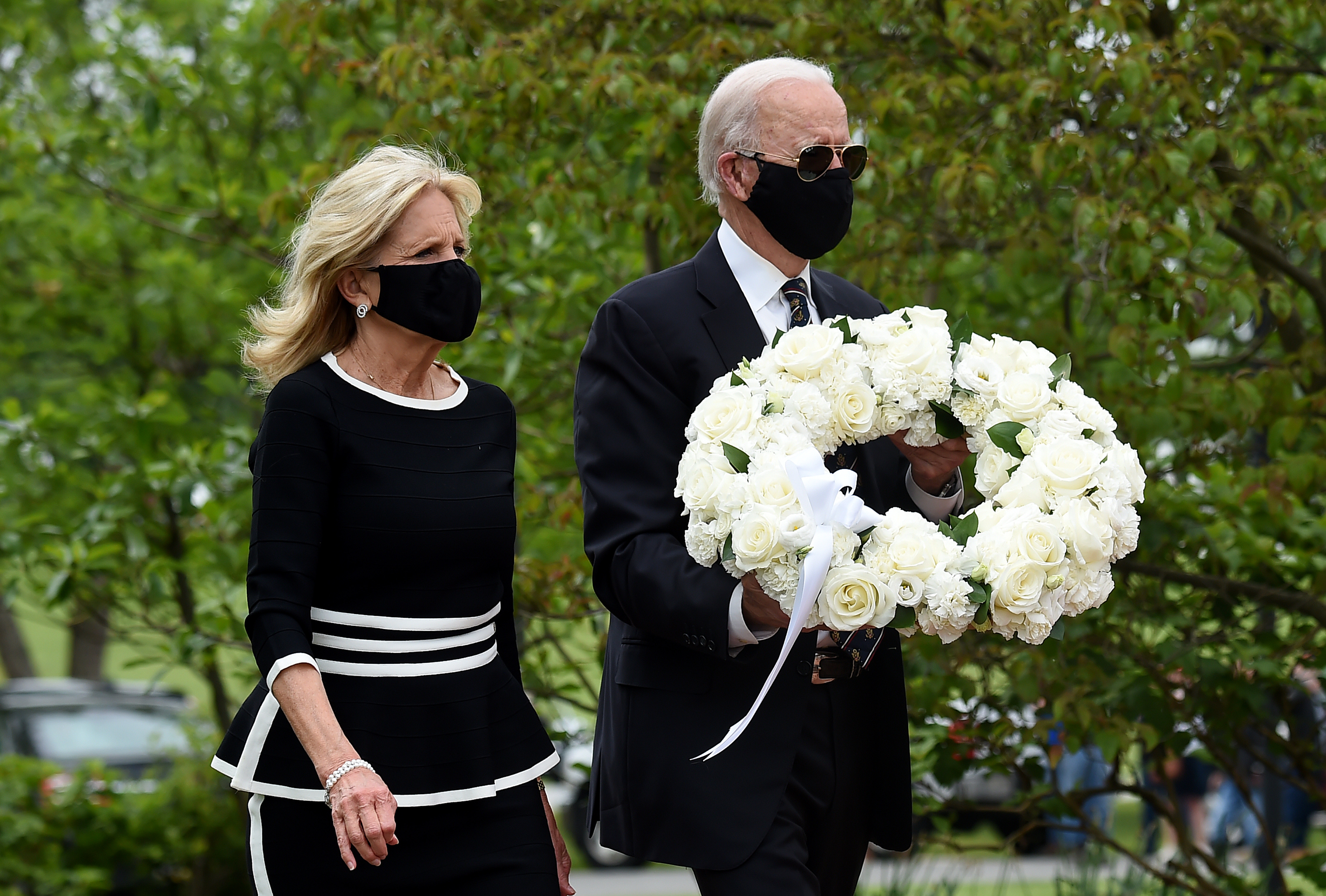 Democratic presidential candidate and former US Vice President Joe Biden with his wife Jill Biden, pay their respects to fallen service members on Memorial Day at Delaware Memorial Bridge Veteran's Memorial Park in Newcastle, Delaware, May 25, 2020. (Photo by OLIVIER DOULIERY/AFP via Getty Images)