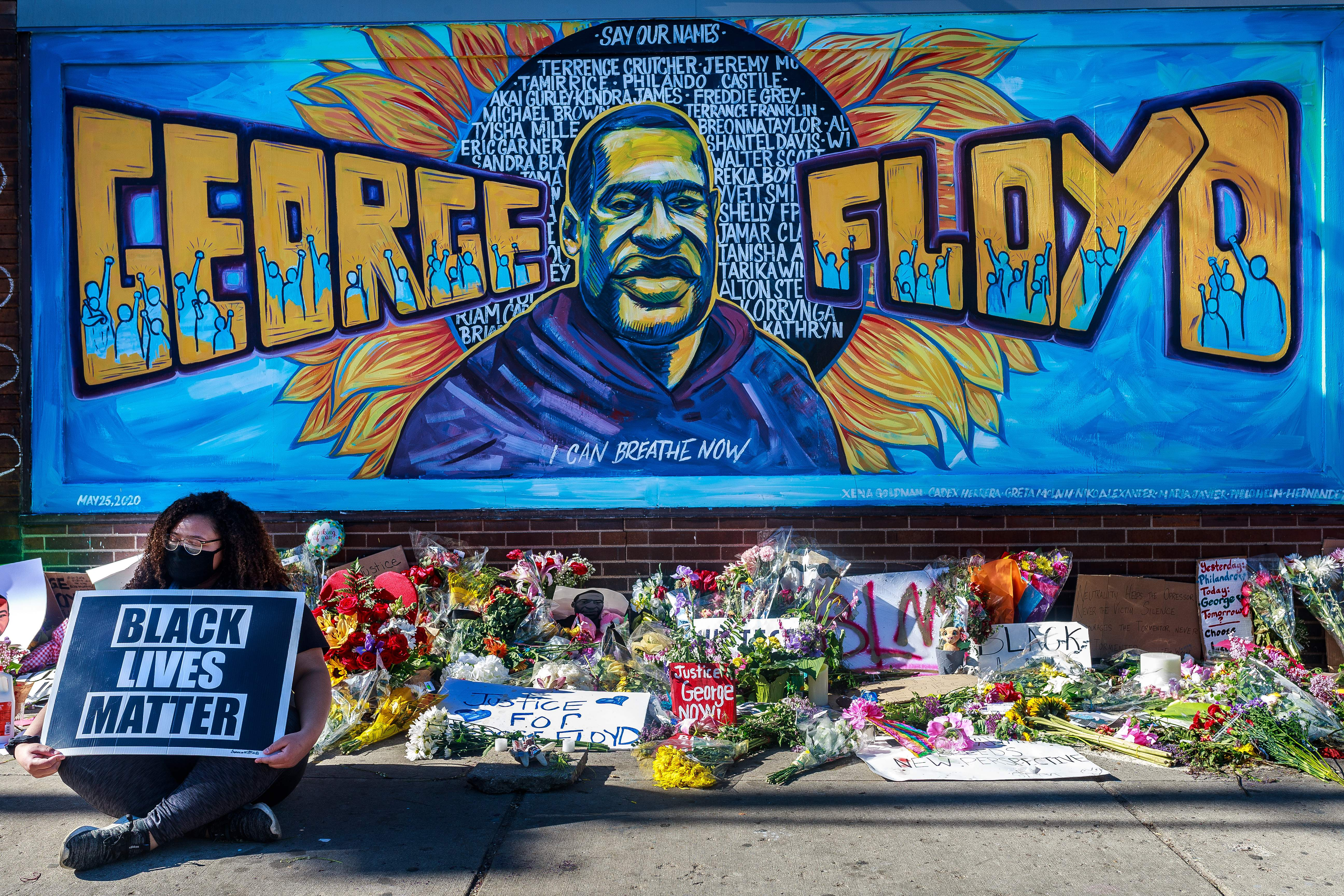 Flowers, signs and balloons are left near a makeshift memorial to George Floyd near the spot where he died while in custody of the Minneapolis police, on May 29, 2020 in Minneapolis, Minnesota. - Demonstrations are being held across the US after George Floyd died in police custody on May 25. (Photo by Kerem Yucel / AFP) (Photo by KEREM YUCEL/AFP via Getty Images)