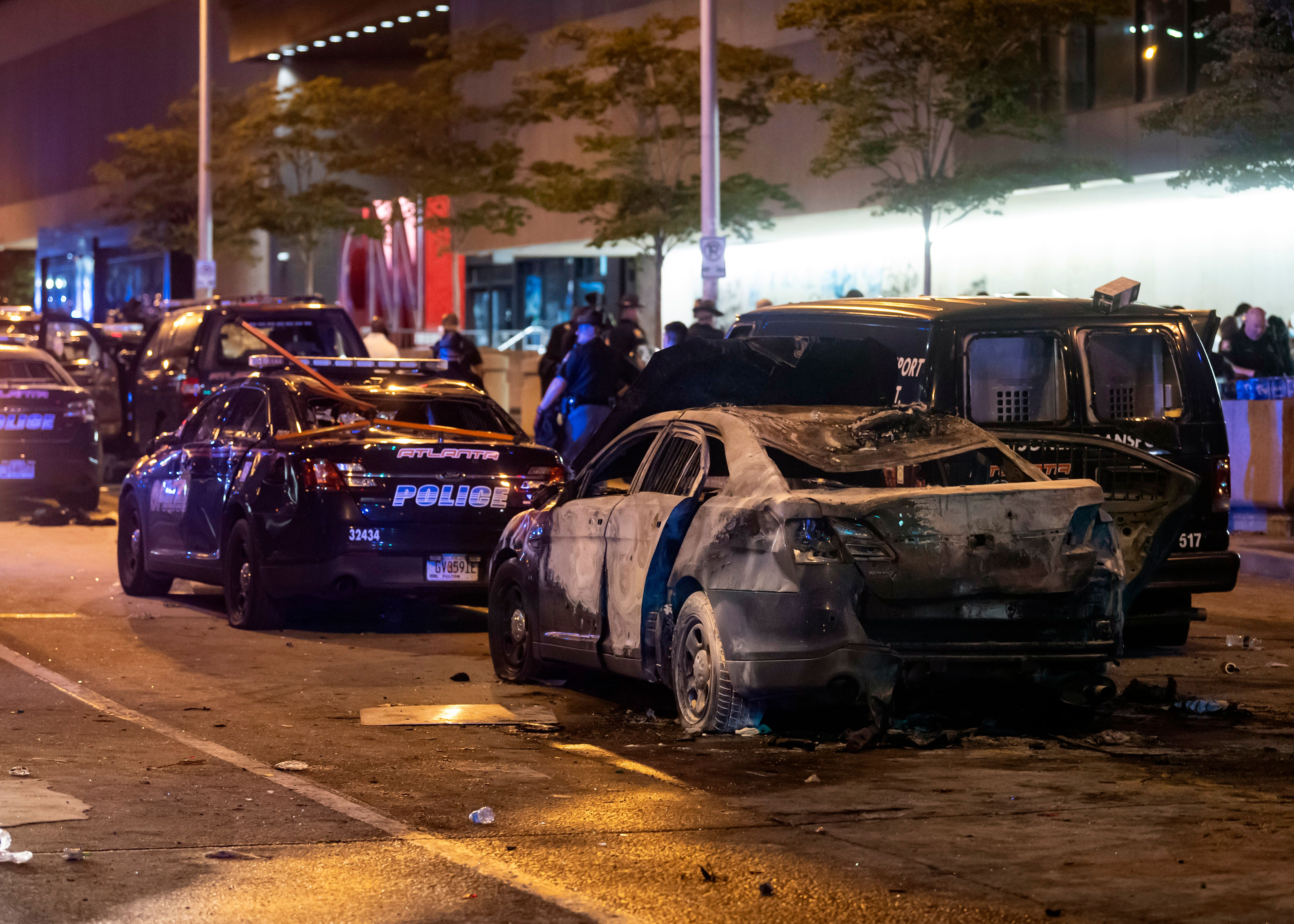 A burned out car sits idle during rioting and protests in Atlanta on May 29, 2020. (Photo by JOHN AMIS/AFP via Getty Images)
