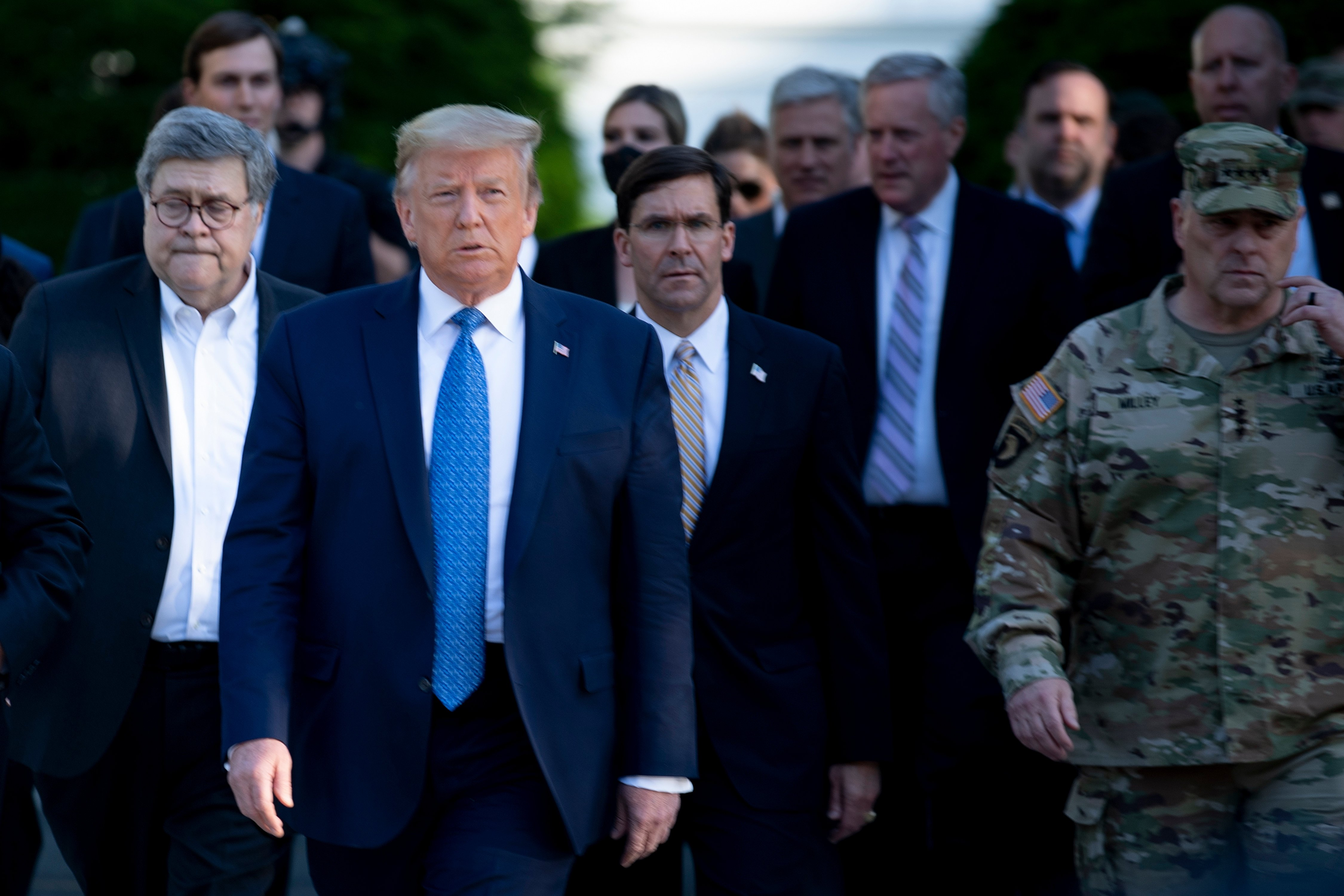 US President Donald Trump walks with US Attorney General William Barr (L), US Secretary of Defense Mark T. Esper (C), Chairman of the Joint Chiefs of Staff Mark A. Milley (R), and others from the White House to visit St. John's Church after the area was cleared of people protesting the death of George Floyd June 1, 2020, in Washington, DC. - US President Donald Trump was due to make a televised address to the nation on Monday after days of anti-racism protests against police brutality that have erupted into violence. The White House announced that the president would make remarks imminently after he has been criticized for not publicly addressing in the crisis in recent days. (Photo by BRENDAN SMIALOWSKI/AFP via Getty Images)
