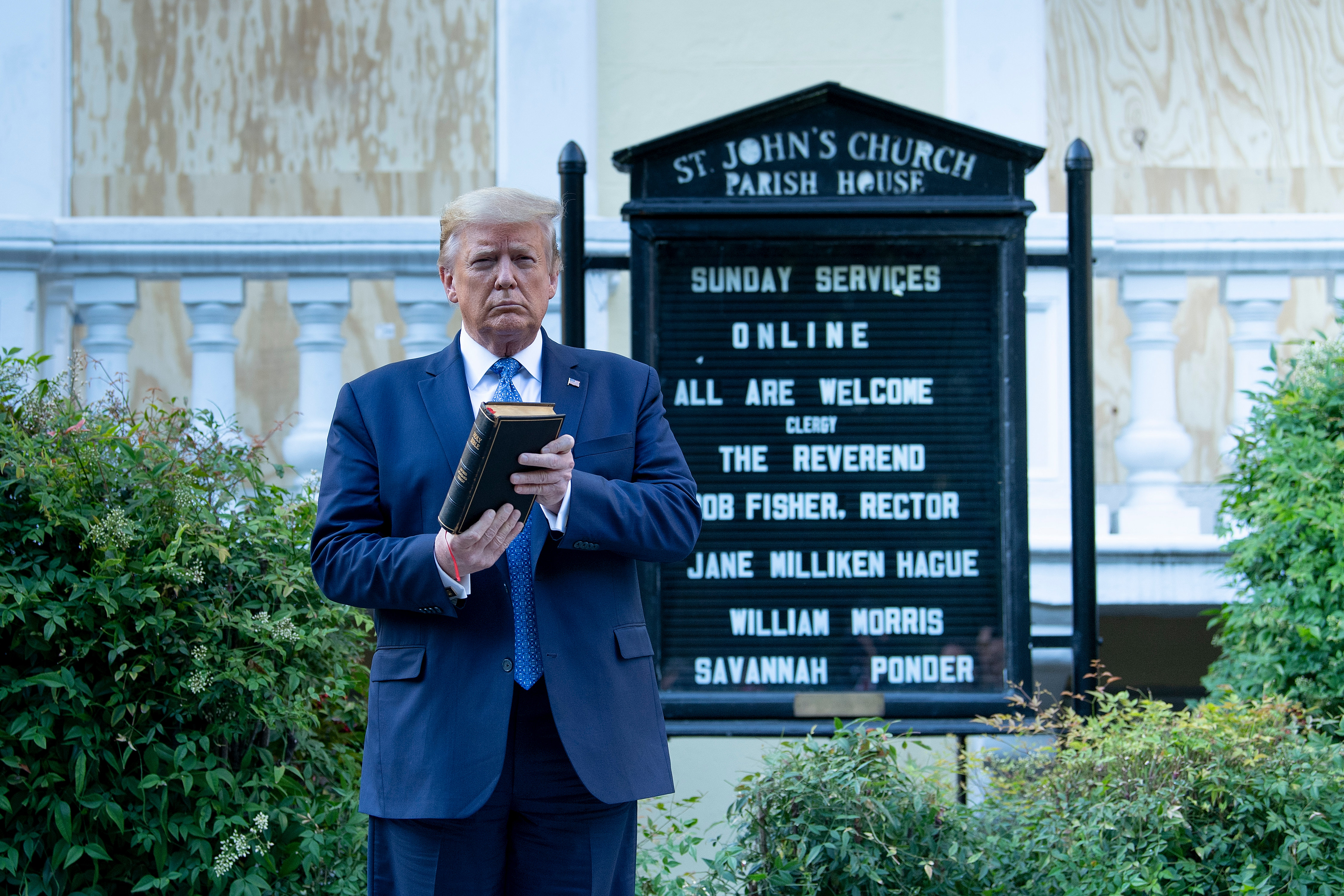 US President Donald Trump holds a Bible while visiting St. John's Church across from the White House after the area was cleared of people protesting the death of George Floyd June 1, 2020, in Washington, DC. - US President Donald Trump was due to make a televised address to the nation on Monday after days of anti-racism protests against police brutality that have erupted into violence.