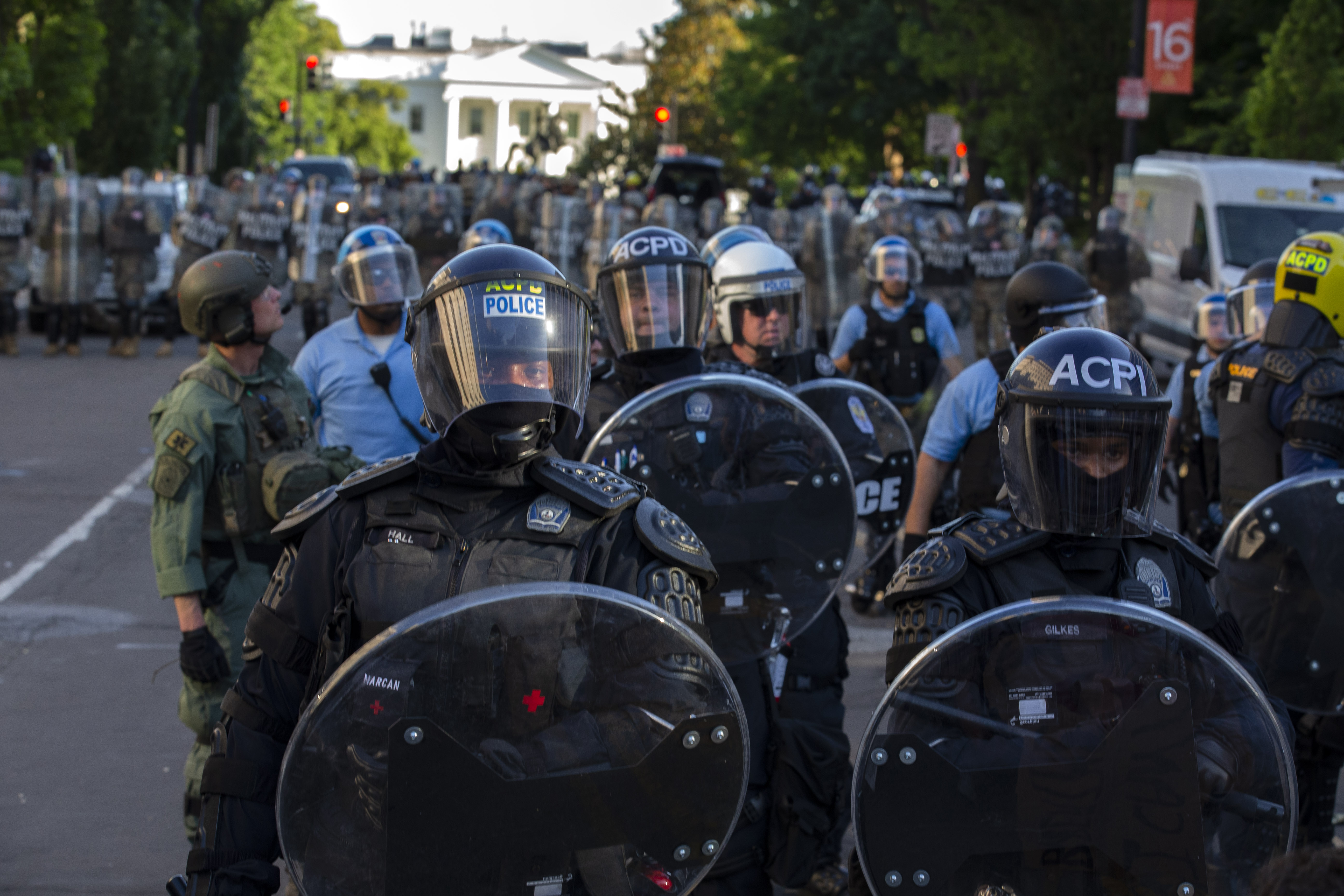 The White House is seen behind a line of police officers wearing riot gear as they push back demonstrators on June 1, 2020 in Washington D.C., during a protest over the death of George Floyd. - (Photo by JOSE LUIS MAGANA/AFP via Getty Images)