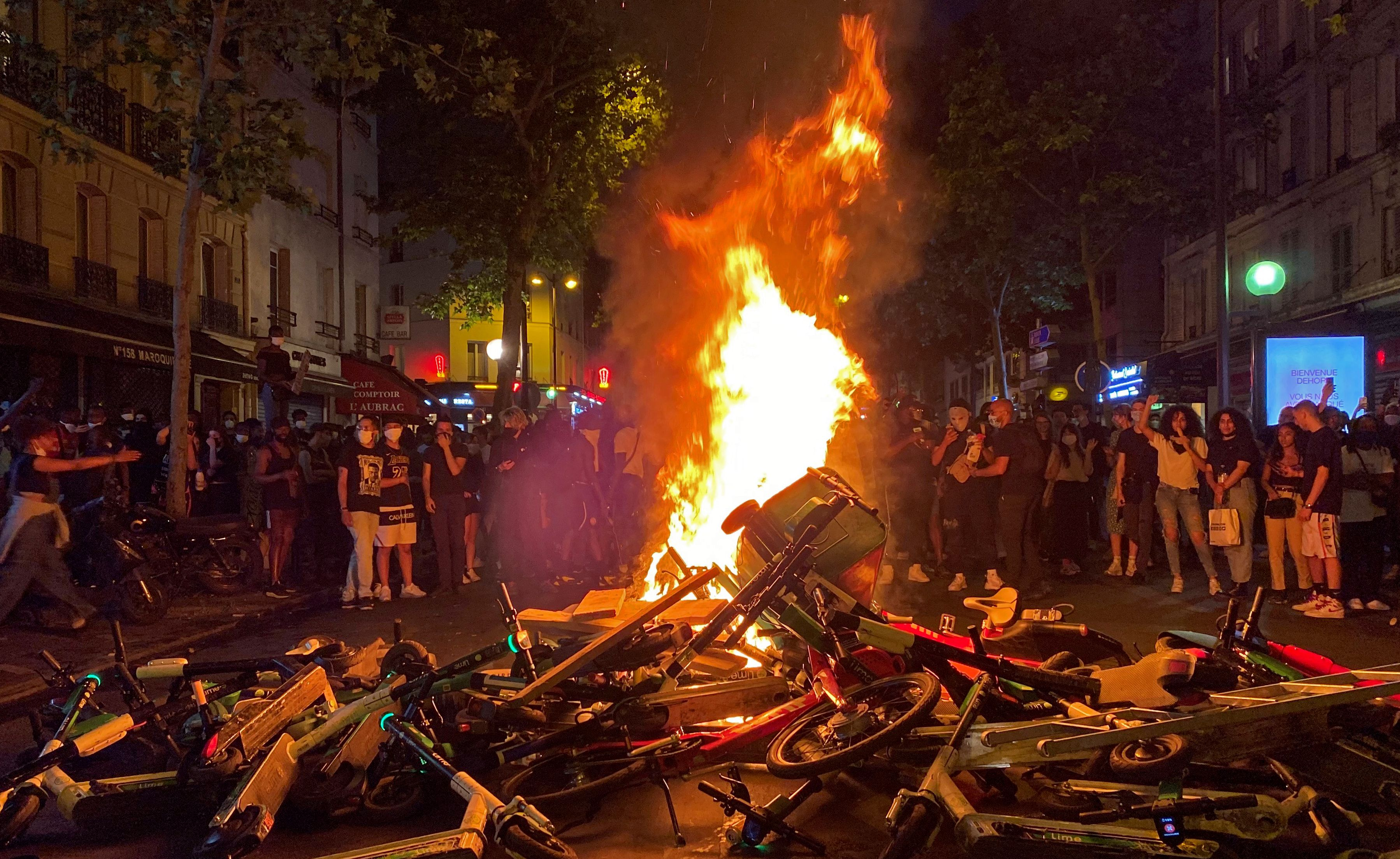 Protesters burn trash bins, shared scooters and bicycles on June 2, 2020 after a demonstration against police violence and in memory of late US citizen George Floyd who died a week before after a Minneapolis police officer knelt on his neck. (Photo by MOHAMMAD GHANNAM/AFP via Getty Images)