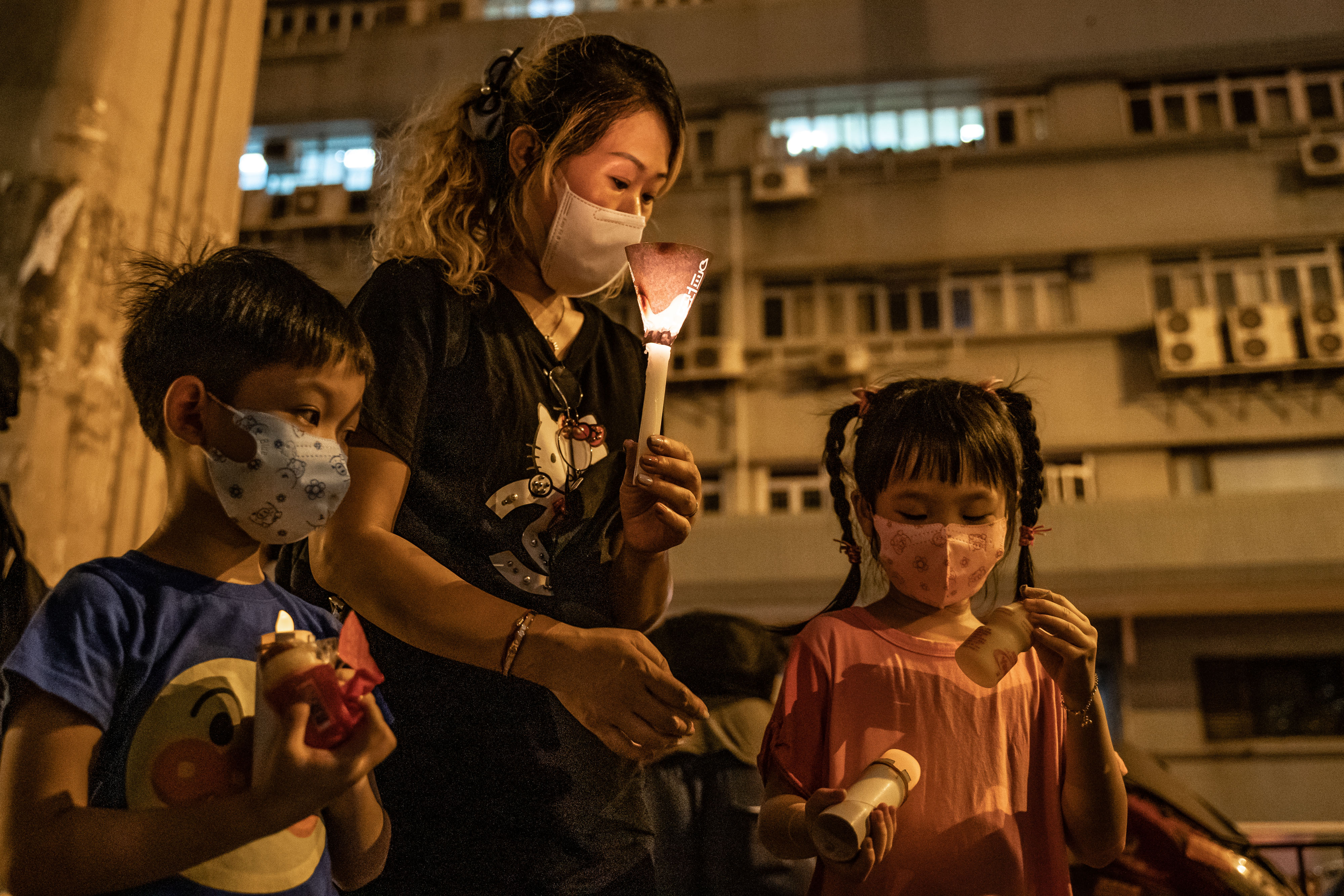 Pro-democracy activists take part in a rally on the eve of Tiananmen Square Massacre candlelight vigil commemoration outside of the Lai Chi Kok Reception Centre on June 3, 2020 in Hong Kong. (Photo by Anthony Kwan/Getty Images)