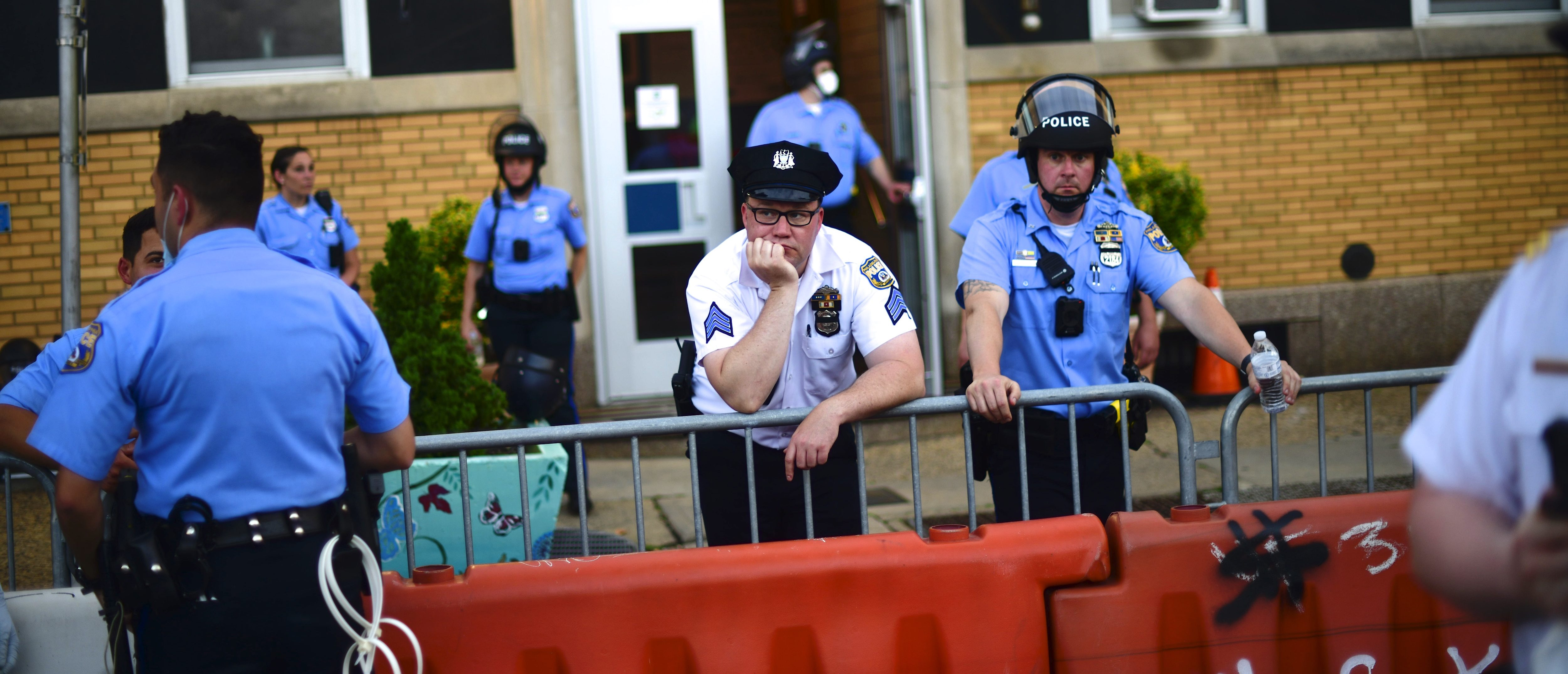 PHILADELPHIA, PA - JUNE 03: Police officers react while observing activists gathering in protest outside the 26th Precinct on June 3, 2020 in Philadelphia, Pennsylvania. Protests continue to erupt in cities throughout the country over George Floyd, the black man who died while in police custody in Minneapolis on May 25. (Photo by Mark Makela/Getty Images)