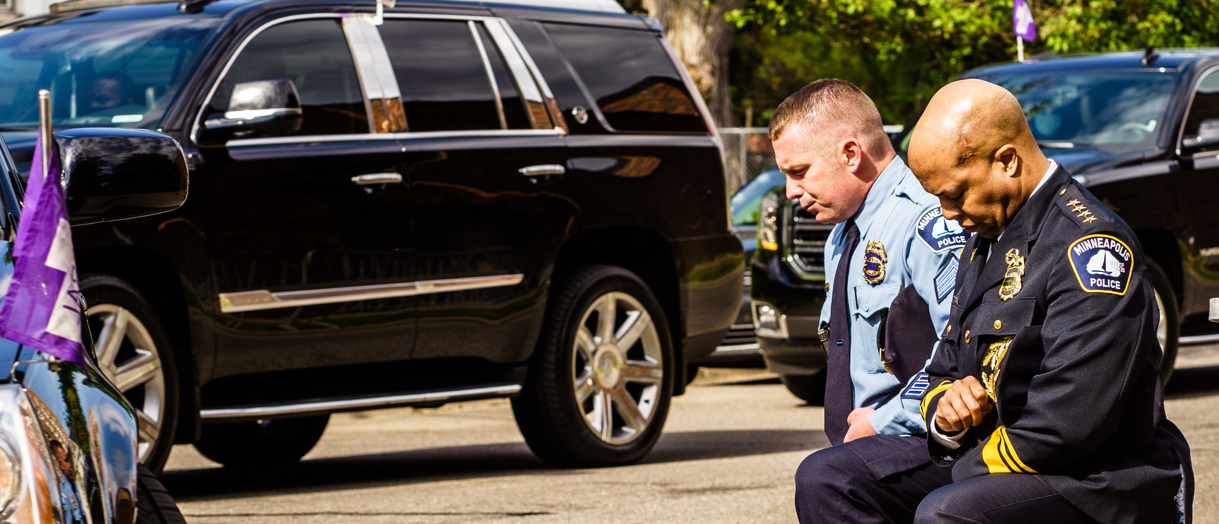 TOPSHOT - Minneapolis Police Chief Medaria Arradondo (R) kneels as the remains of George Floyd are taken to a memorial service in his honor on June 4, 2020, in Minneapolis, Minnesota. - On May 25, 2020, Floyd, a 46-year-old black man suspected of passing a counterfeit $20 bill, died in Minneapolis after Derek Chauvin, a white police officer, pressed his knee to Floyd's neck for almost nine minutes. (Photo by kerem yucel / AFP) (Photo by KEREM YUCEL/AFP via Getty Images)