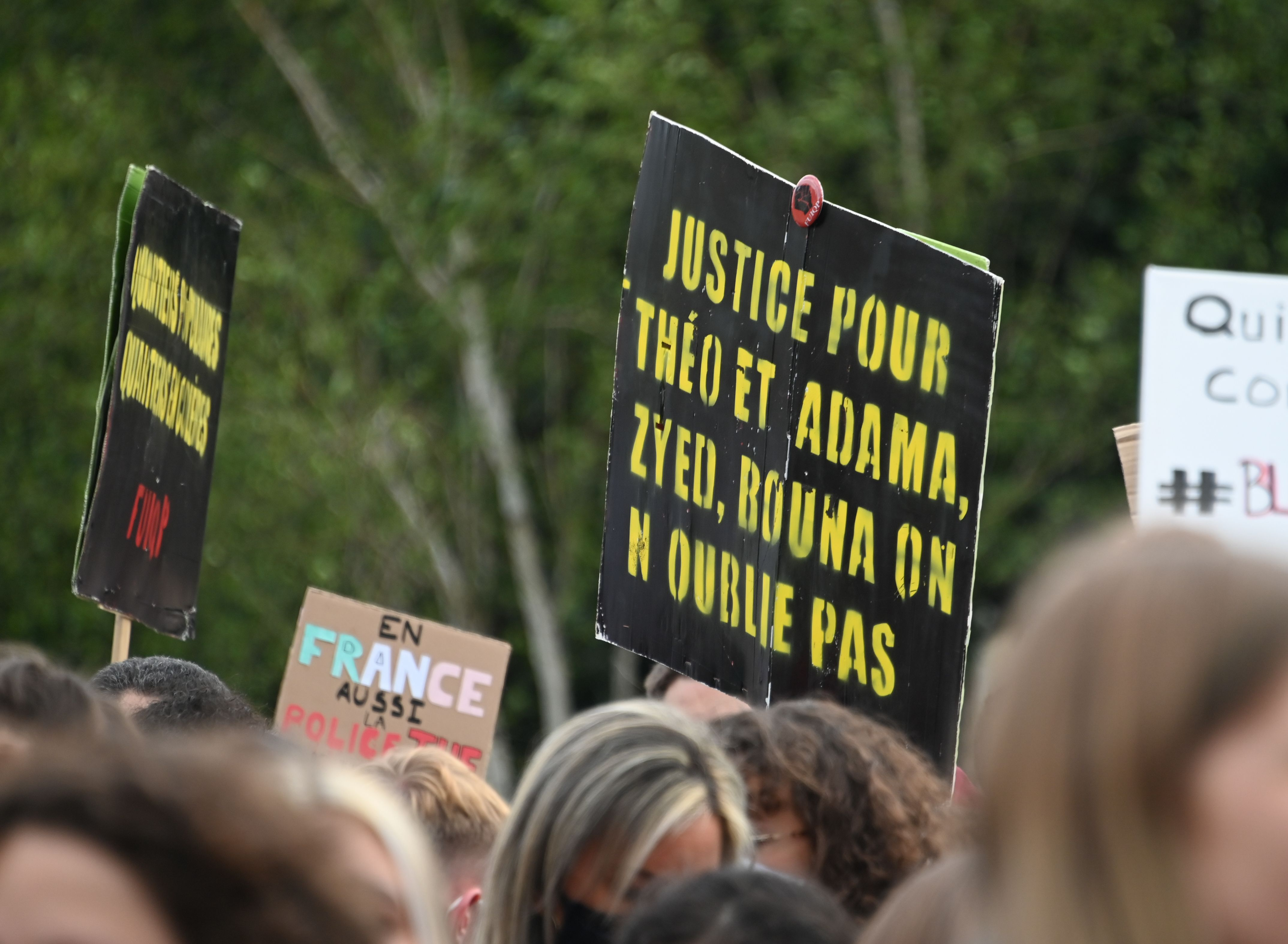 """A person holds a placard reading """"Justice for Theo, Adama, Zyed, Bouma... We don't forget"""" during a demonstration on June 4, 2020, in Lille, northern France, against racism and police violence. (Photo by DENIS CHARLET/AFP via Getty Images)"""