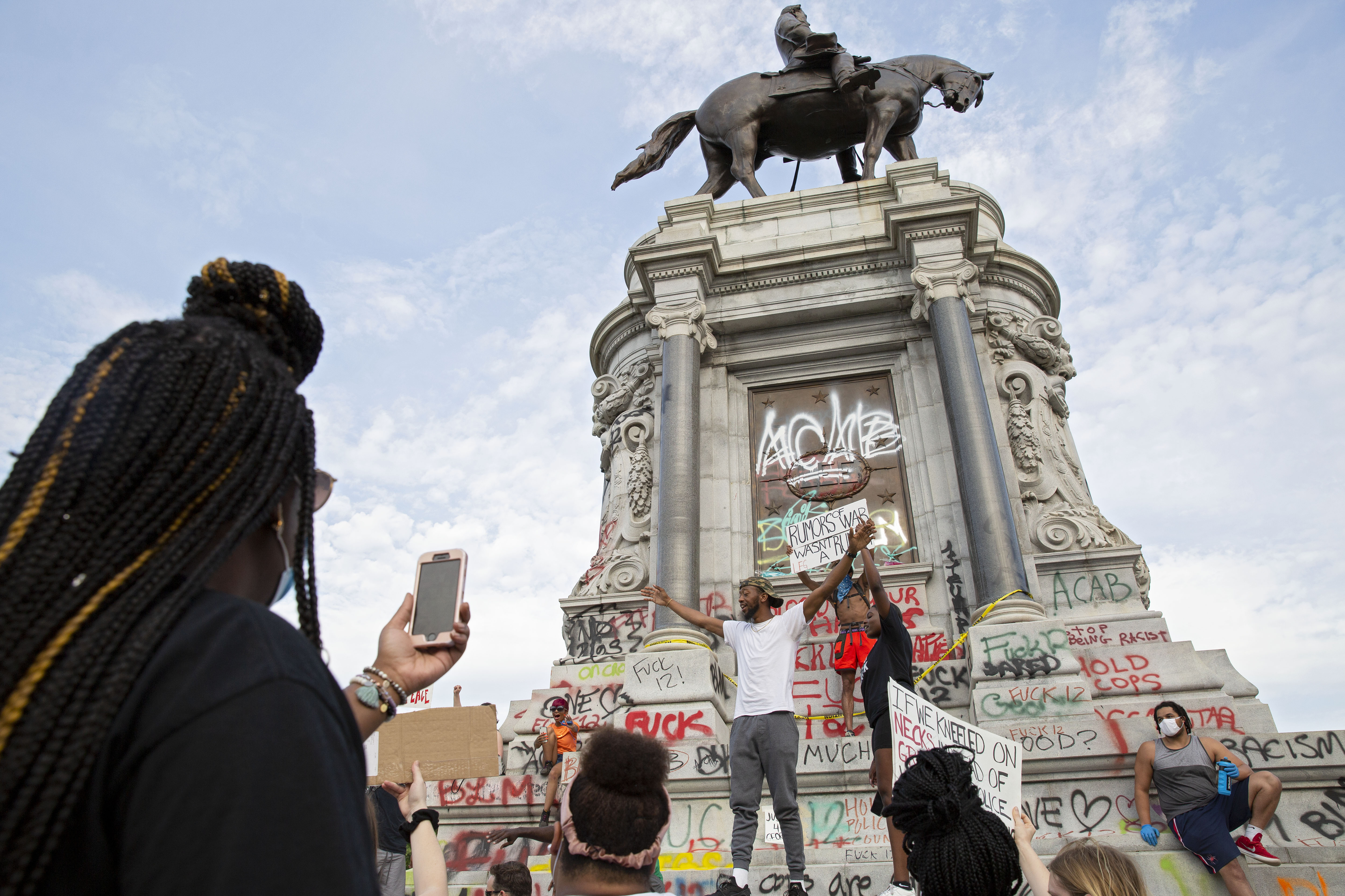 People gather around the Robert E. Lee statue on Monument Avenue in Richmond, Virginia, on June 4, 2020, amid continued protests over the death of George Floyd in police custody. - (Photo by RYAN M. KELLY/AFP via Getty Images)