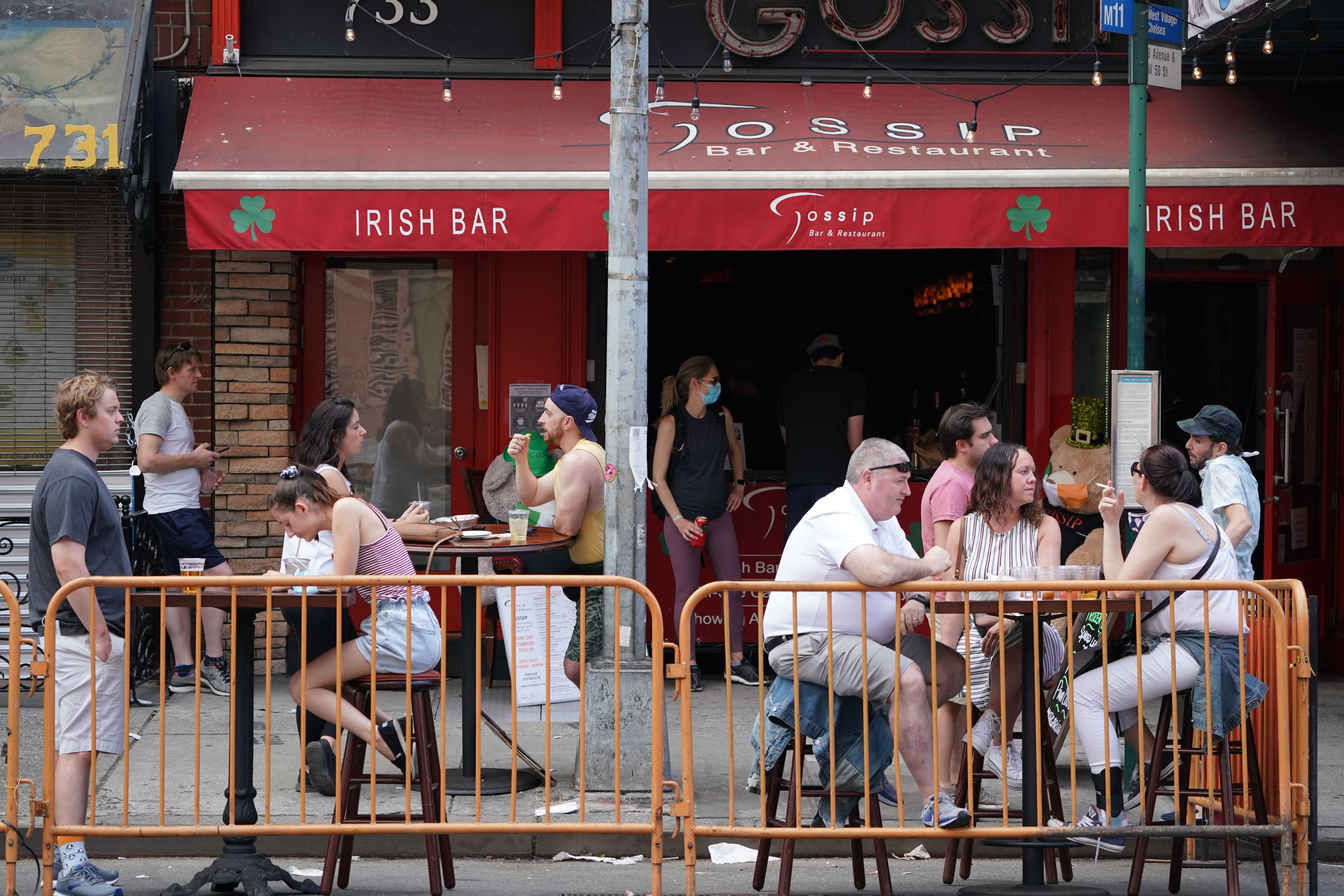 People drink outdoors at bars and restaurants in the Hells Kitchen neighborhood of New York on June 7, 2020. (Photo by BRYAN R. SMITH/AFP via Getty Images)