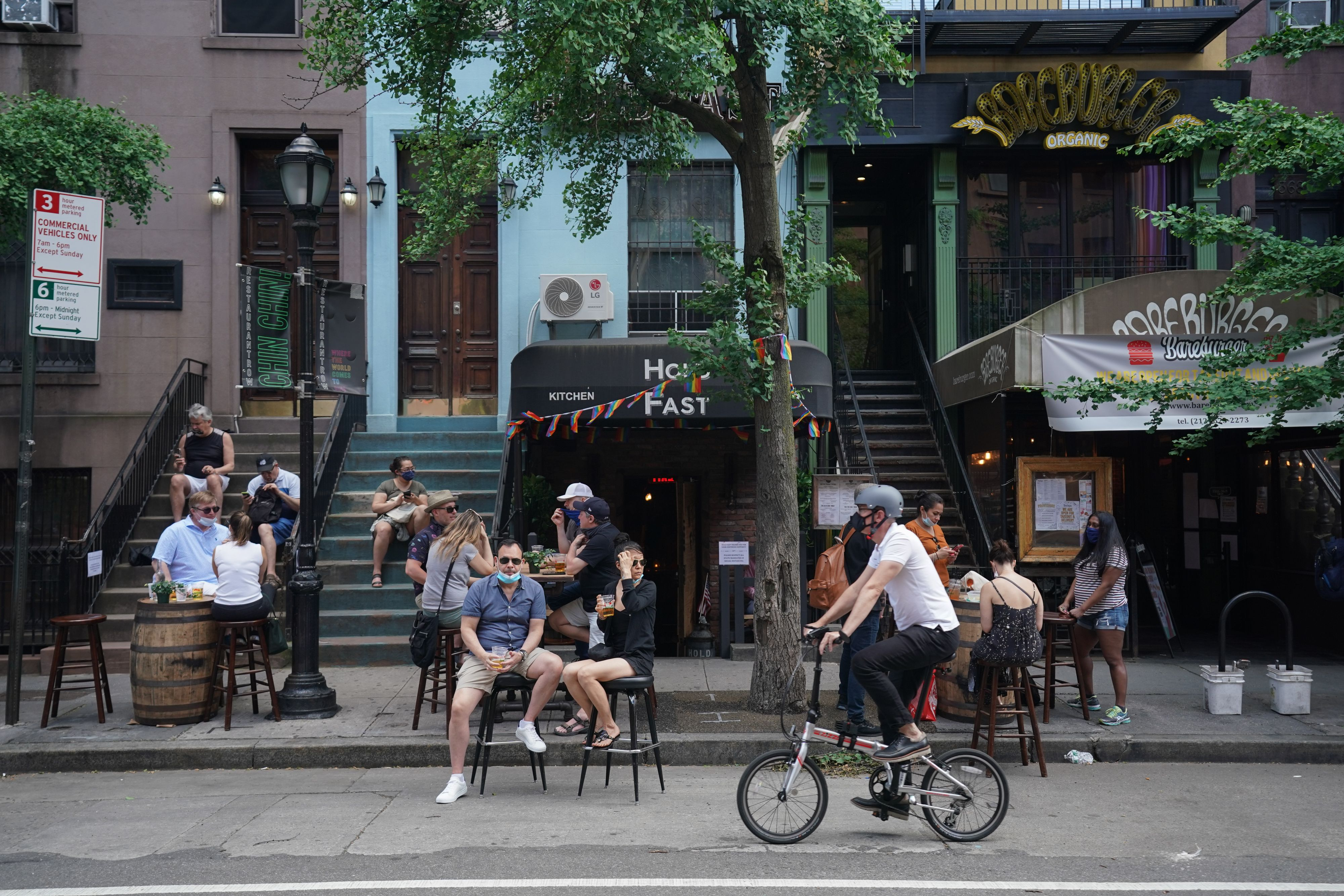 People drink outdoor at bars and restaurants in the Hells Kitchen neighborhood of New York on June 7, 2020. (Photo by BRYAN R. SMITH/AFP via Getty Images)