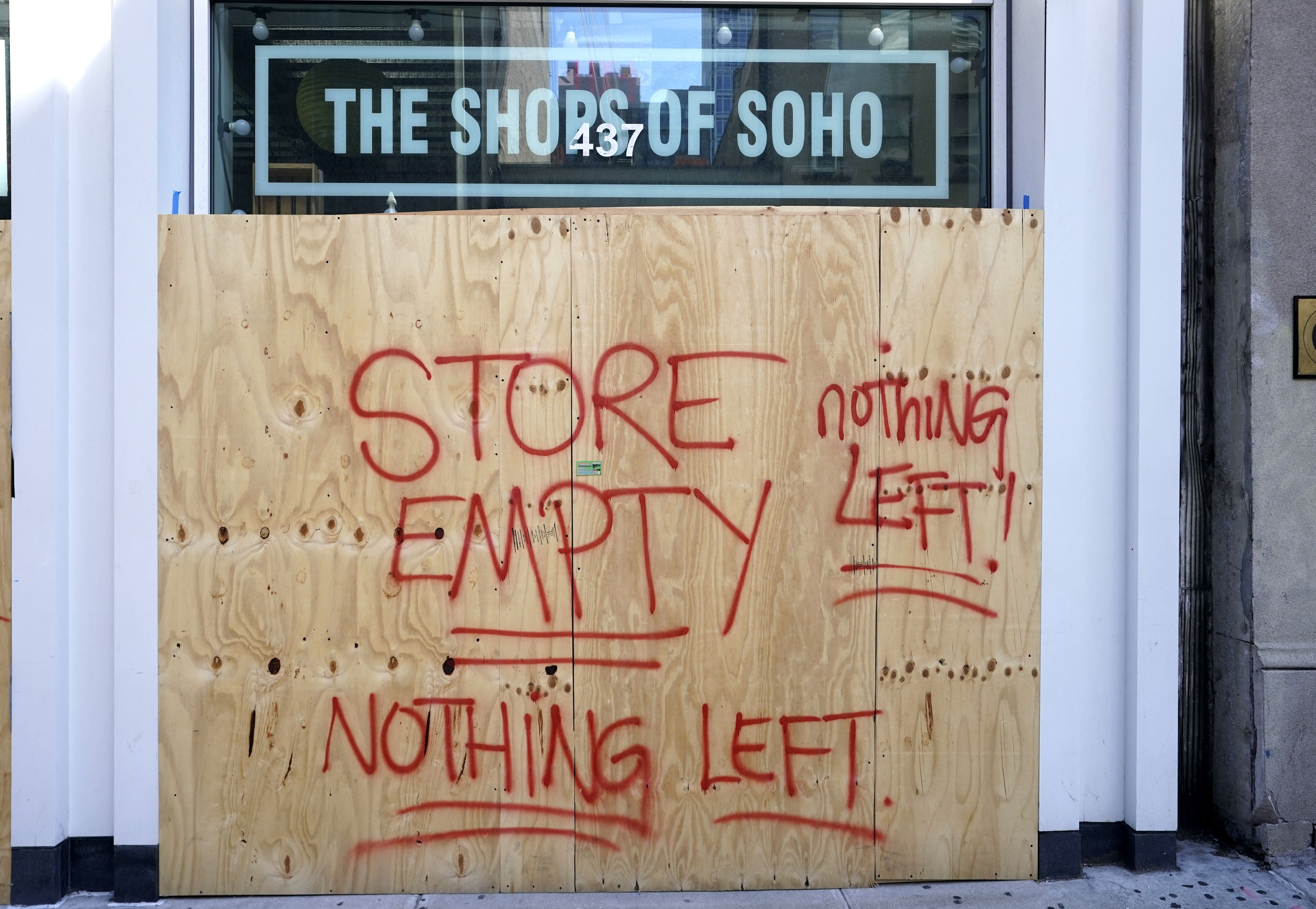 The Shoes of Soho store is seen boarded up on June 8, 2020 after rampant open looting and vandalism in New York, following the Minneapolis police killing of George Floyd. (Photo by TIMOTHY A. CLARY/AFP via Getty Images)