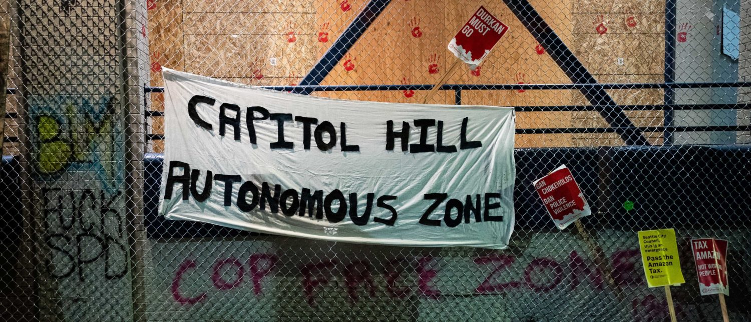 "SEATTLE, WA - JUNE 09: A ""Capitol Hill Autonomous Zone"" sign hangs on the exterior of the Seattle Police Departments East Precinct on June 9, 2020 in Seattle, Washington. Protests have continued in many parts of the city including inside City Hall and around the Seattle Police Departments East Precinct, an area that has earned the moniker ""Capitol Hill Autonomous Zone,"" during ongoing Black Lives Matter protests in the wake of George Floyds death. (Photo by David Ryder/Getty Images)"