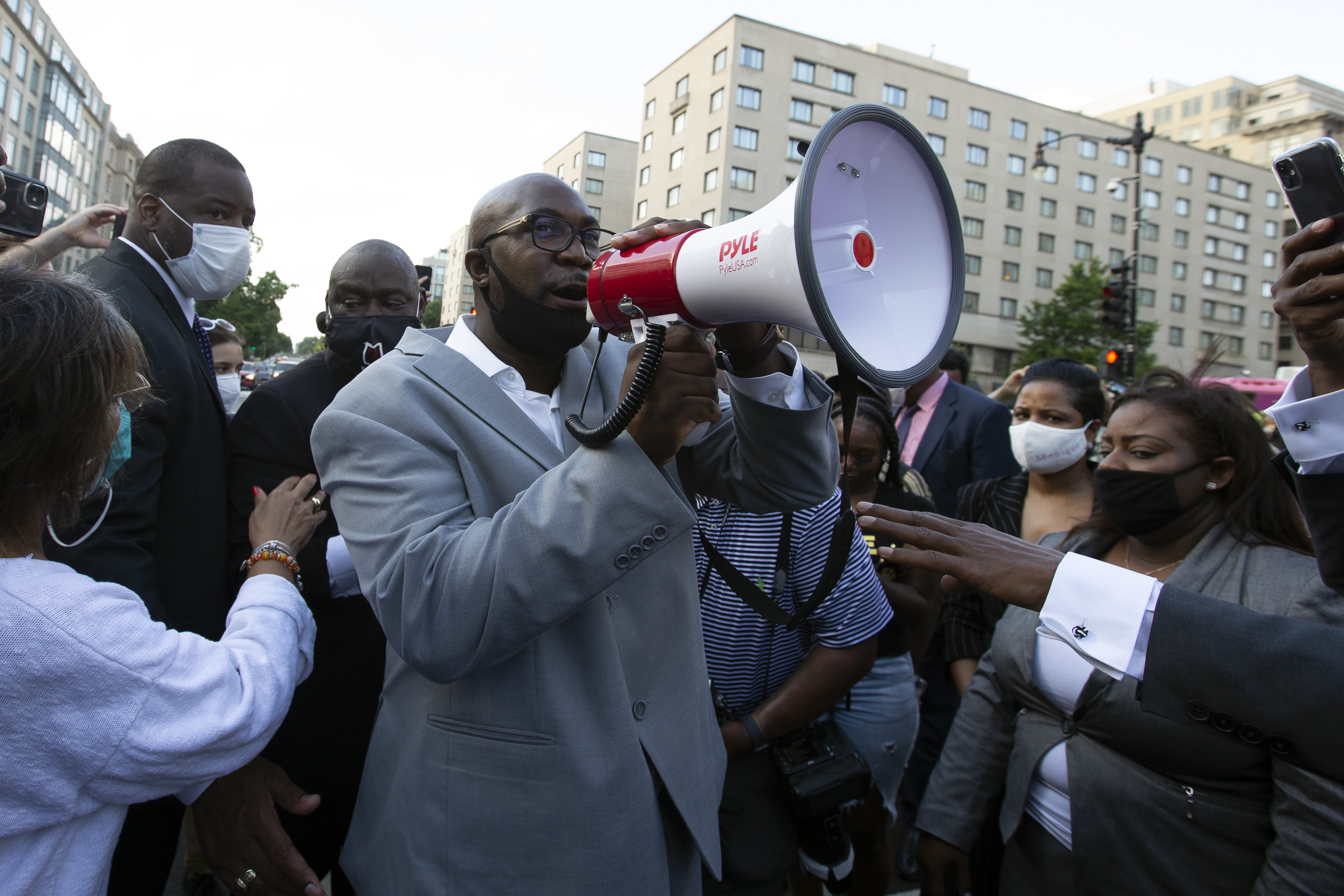 Philonise Floyd (C), George Floyd's brother, speaks to a crowd as he marches with others on Black Lives Matter Plaza near the White House, to protest police brutality and racism, on June 10, 2020 in Washington, DC. (Photo by JOSE LUIS MAGANA/AFP via Getty Images)