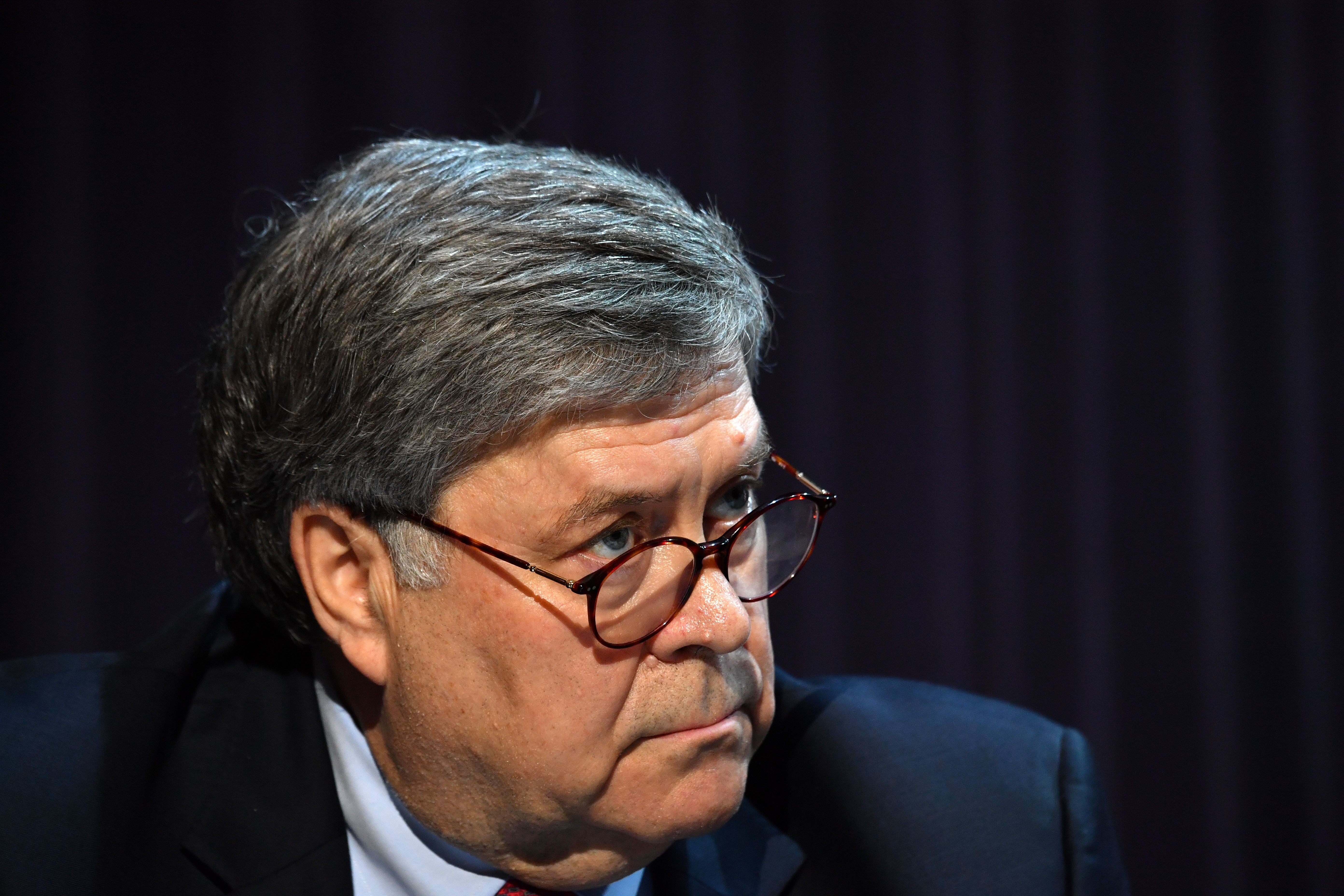 US Attorney General William Barr looks on during a roundtable with US President Donald Trump,faith leaders and small business owners at Gateway Church Dallas Campus in Dallas, Texas, on June 11, 2020. (Photo by NICHOLAS KAMM/AFP via Getty Images)