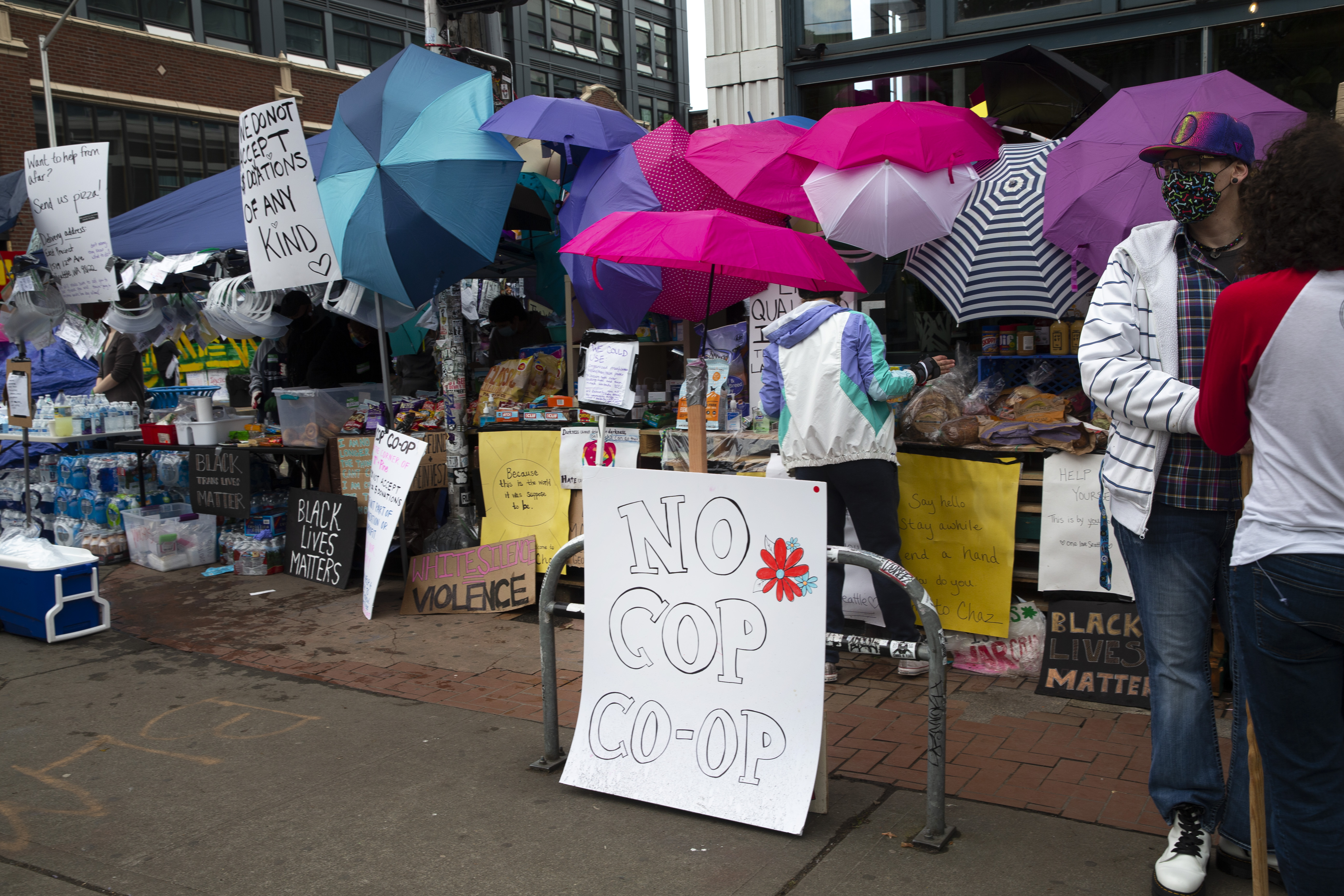 Many stands offering free items have been set up including the No Cop Co-op in an area dubbed the Capitol Hill Autonomous Zone (CHAZ) on June 12, 2020 in Seattle.(Photo: Karen Ducey/Getty Images)