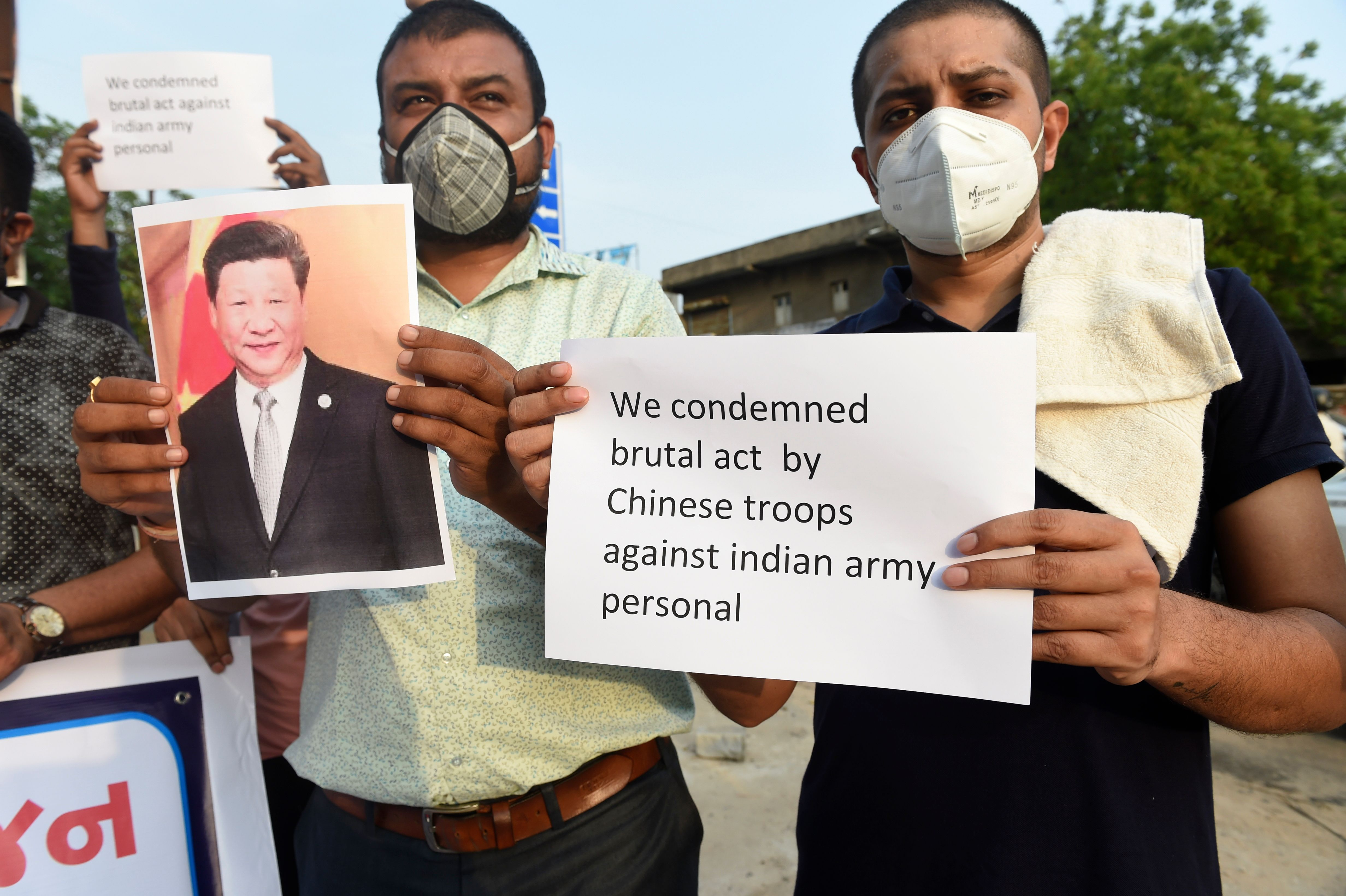 Indian citizens hold placards and shout slogans as they protest against the killing of three Indian soldiers by Chinese troops, on June 16, 2020. (Photo: Sam Panthaky/AFP via Getty Images)