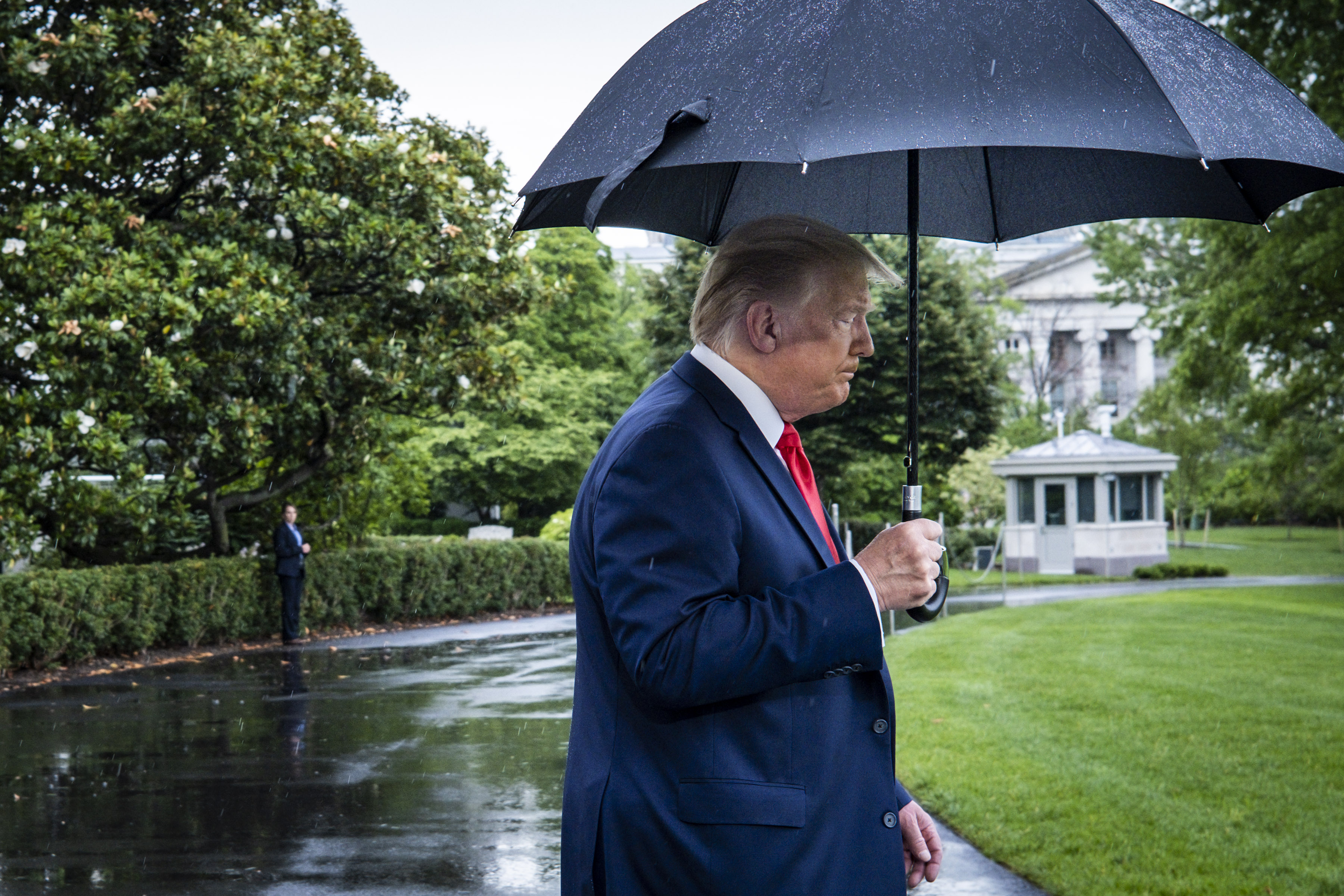 WASHINGTON, DC - JUNE 20:President Donald Trump walks in the rain toward Marine One after stopping to speak to the media on the South Lawn of the White House as he prepares to depart for a rally in Tulsa, OK, on June 20, 2020 in Washington, DC. The rally is Trump's first in months since the coronavirus lockdown and his campaign acknowledged that six staff members had tested positive for the virus during routine screening. (Photo by Pete Marovich/Getty Images)