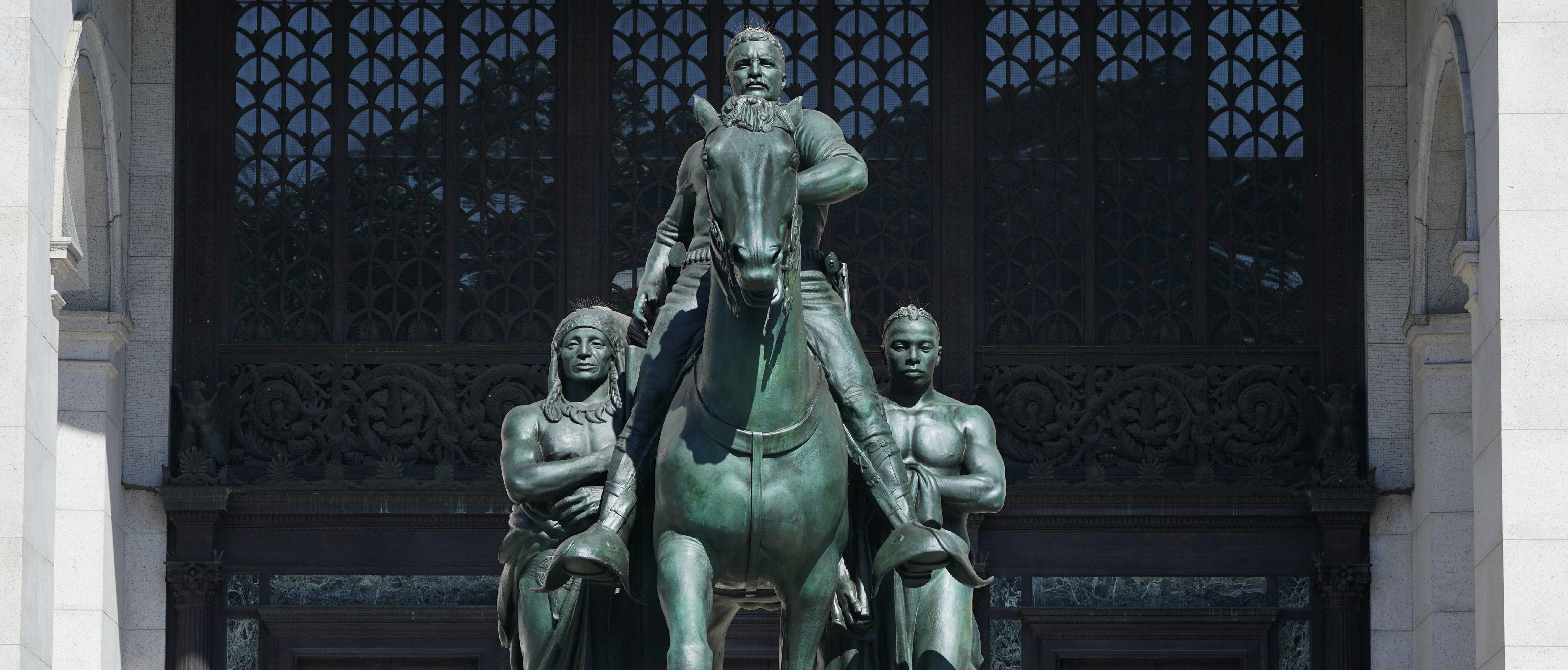 The Theodore Roosevelt Equestrian Statue, which sits on New York City public park land is seen in front of the The American Museum of Natural History on Central Park West entrance June 22,2020. - The American Museum of Natural History will remove the Theodore Roosevelt from its entrance after objections that it symbolizes colonial expansion and racial discrimination, Mayor Bill de Blasio said. (Photo by TIMOTHY A. CLARY/AFP via Getty Images)