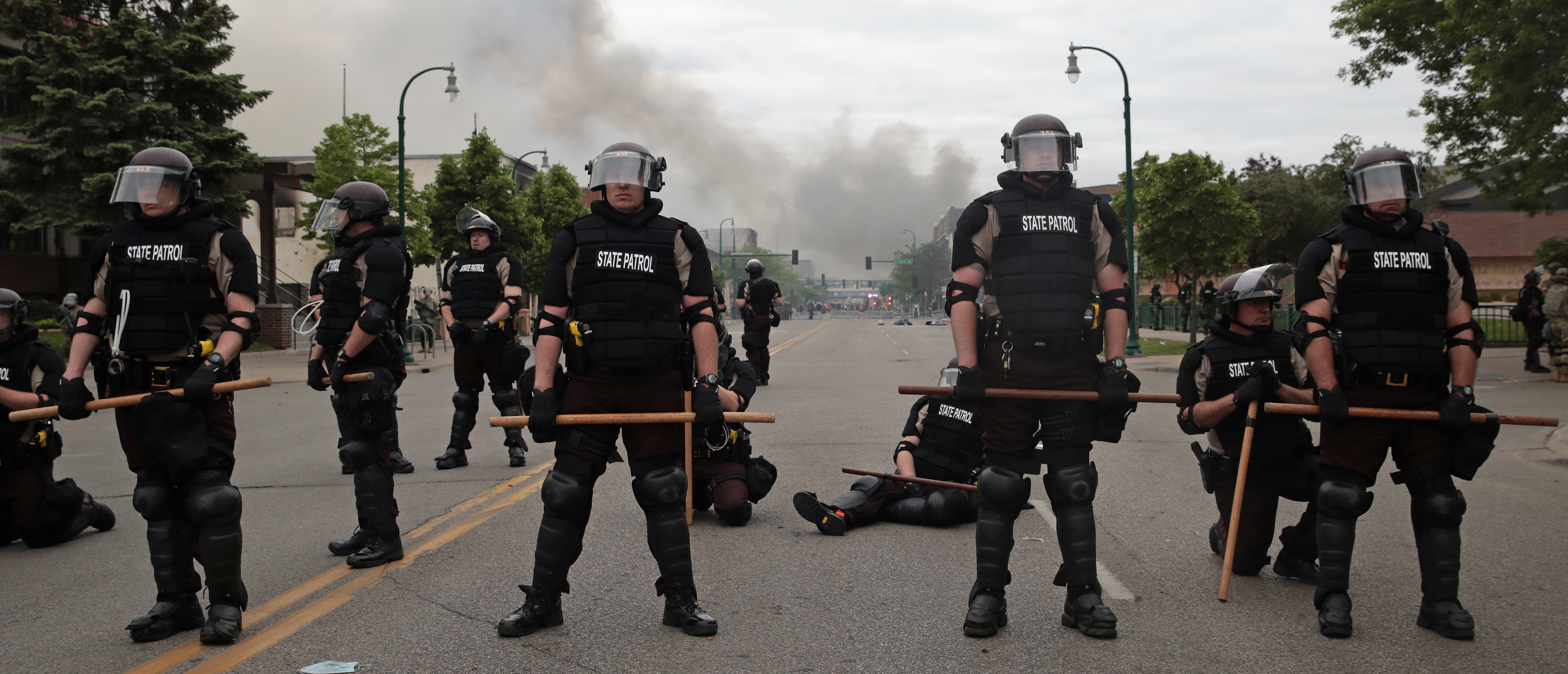 Police officers block a road on the fourth day of protests on May 29, 2020 in Minneapolis, Minnesota. The National Guard has been activated as protests continue after the death of George Floyd which has caused widespread destruction and fires across Minneapolis and St. Paul. (Photo by Scott Olson/Getty Images)