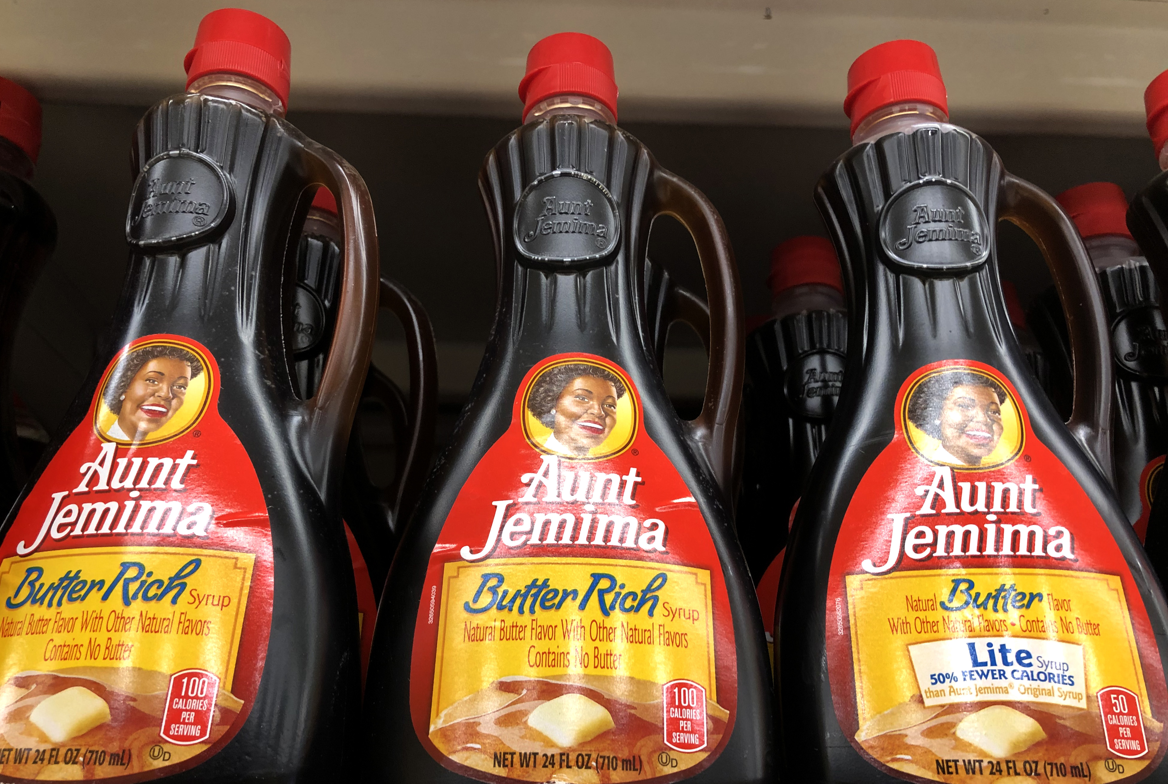 Bottles of Aunt Jemima pancake syrup are displayed on a shelf at a Safeway store on June 17, 2020 in San Anselmo, California. (Photo by Justin Sullivan/Getty Images)