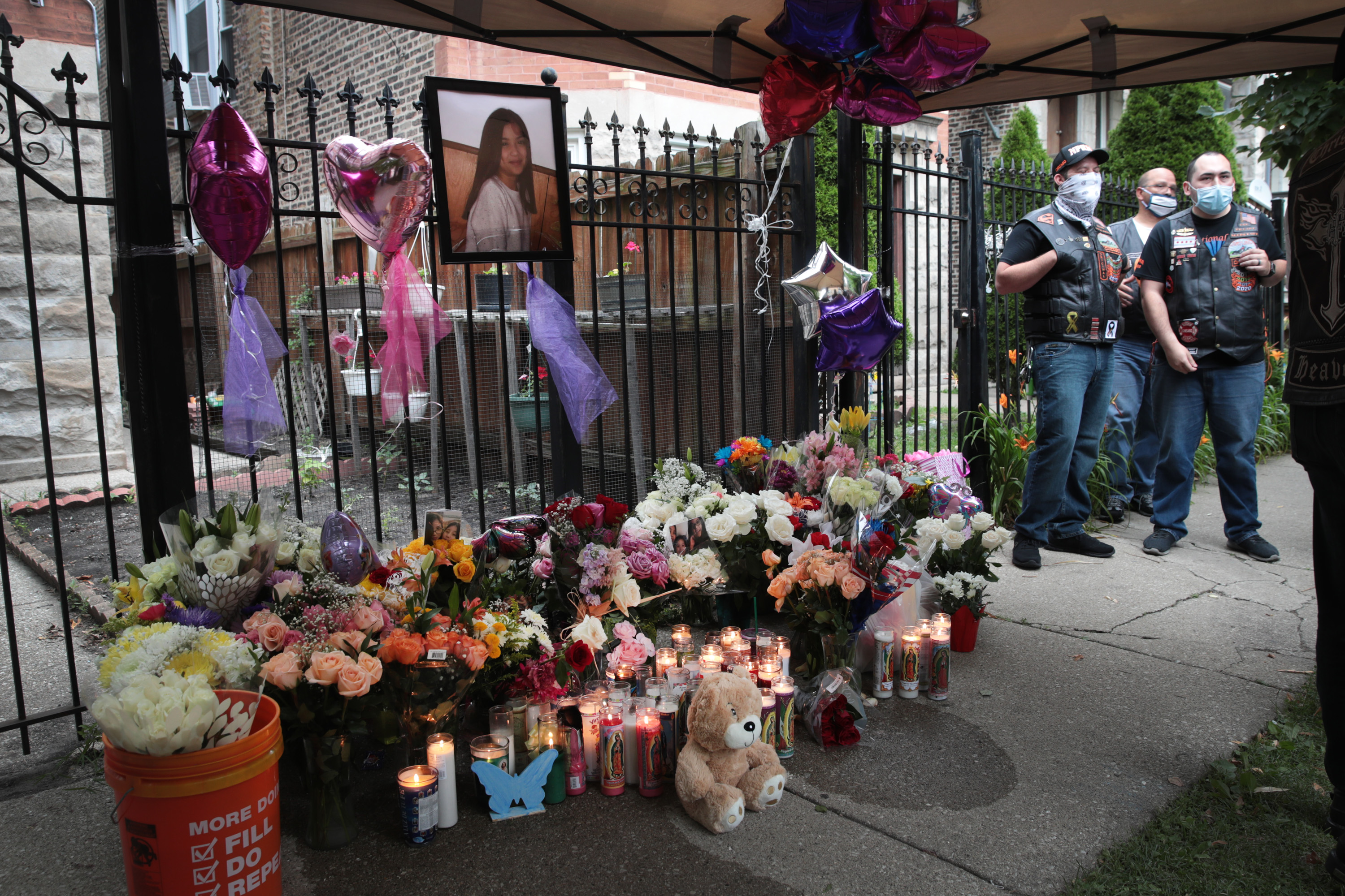Candles burn in front of a memorial for for 10-year-old Lena Nunez on June 29, 2020 in Chicago, Illinois. Nunez was shot and killed by a stray bullet while watching television with her brother in her grandmother's home on Saturday evening. (Photo: Scott Olson/Getty Images)