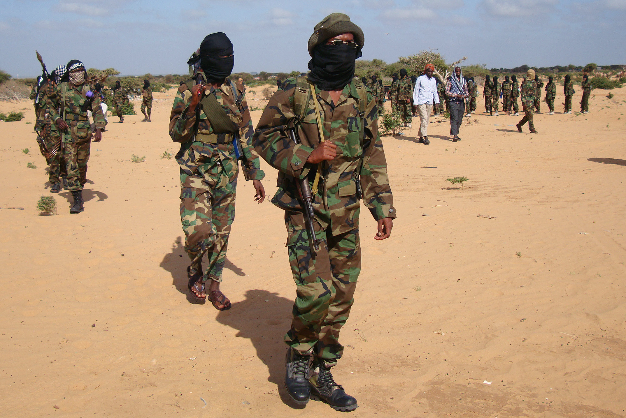 Somali Al-Shebab fighters gather on February 13, 2012 in Elasha Biyaha, in the Afgoei Corridor, after a demonstration to support the merger of Al-shebab and the Al-Qaeda network. (Mohamed Abdiwahab/AFP via Getty Images)
