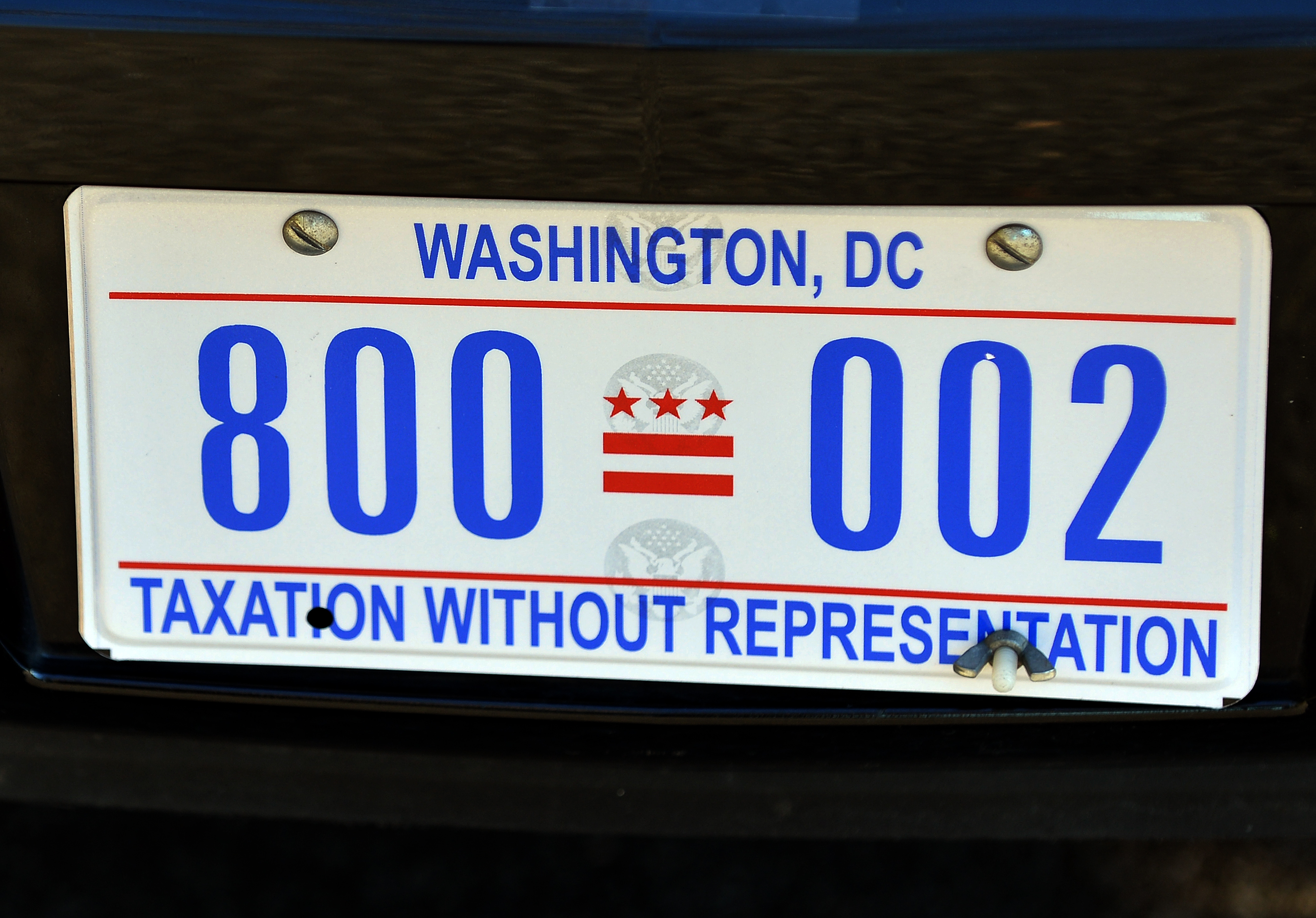"""The license plate of US President Barack Obama's limo is pictured on January 19, 2013 in Washington DC. Obama's limousine is now adorned withe """"Taxation Without Representation"""" license plates. The DC government authorized the plates to protest the fact that the District of Columbia does not have a vote in Congress. AFP PHOTO/Jewel Samad (JEWEL SAMAD/AFP via Getty Images)"""