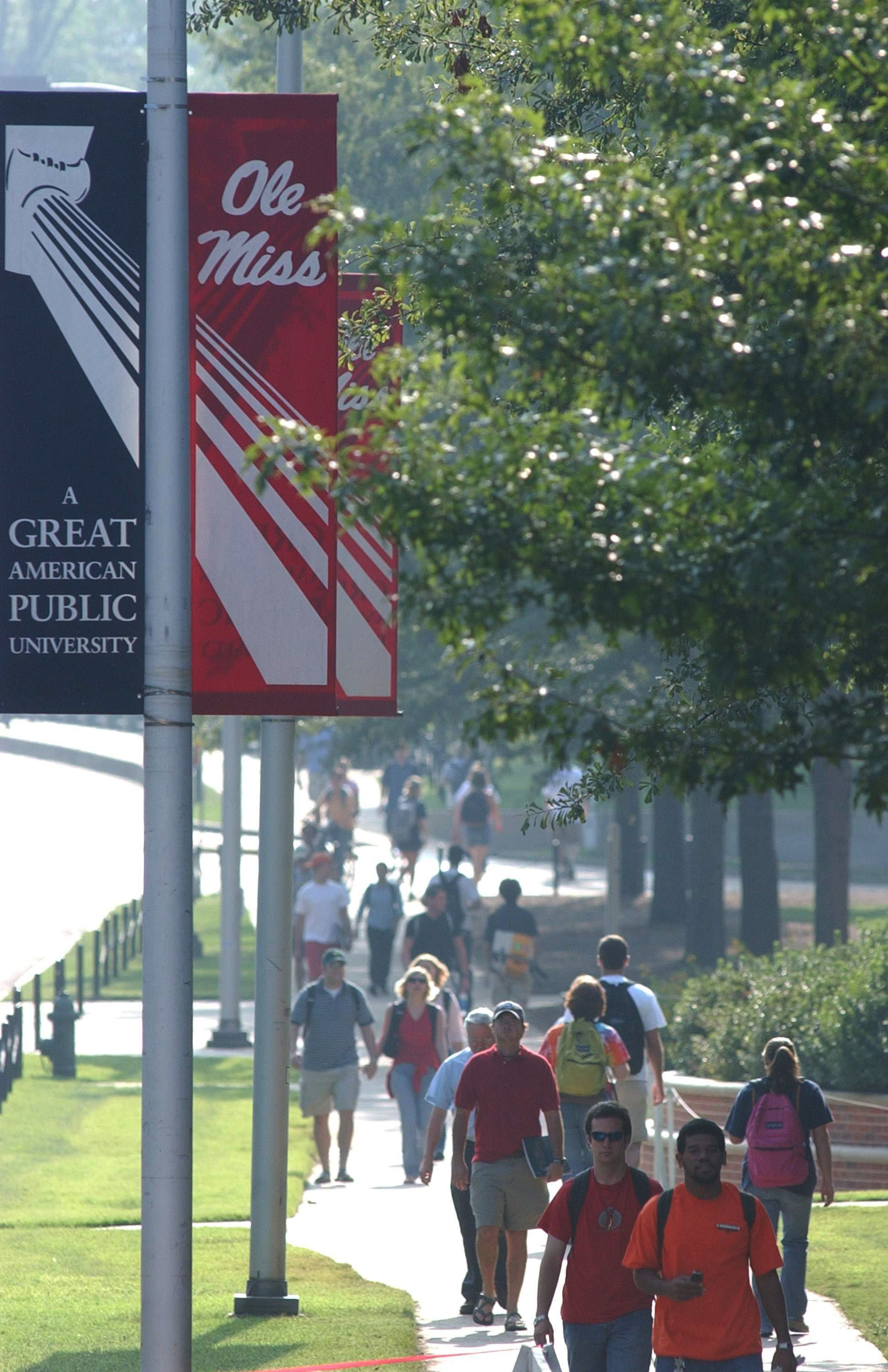 Students walk along the campus of the University of Mississippi in Oxford, Mississippi. (Photo by Bruce Newman/Getty Images)