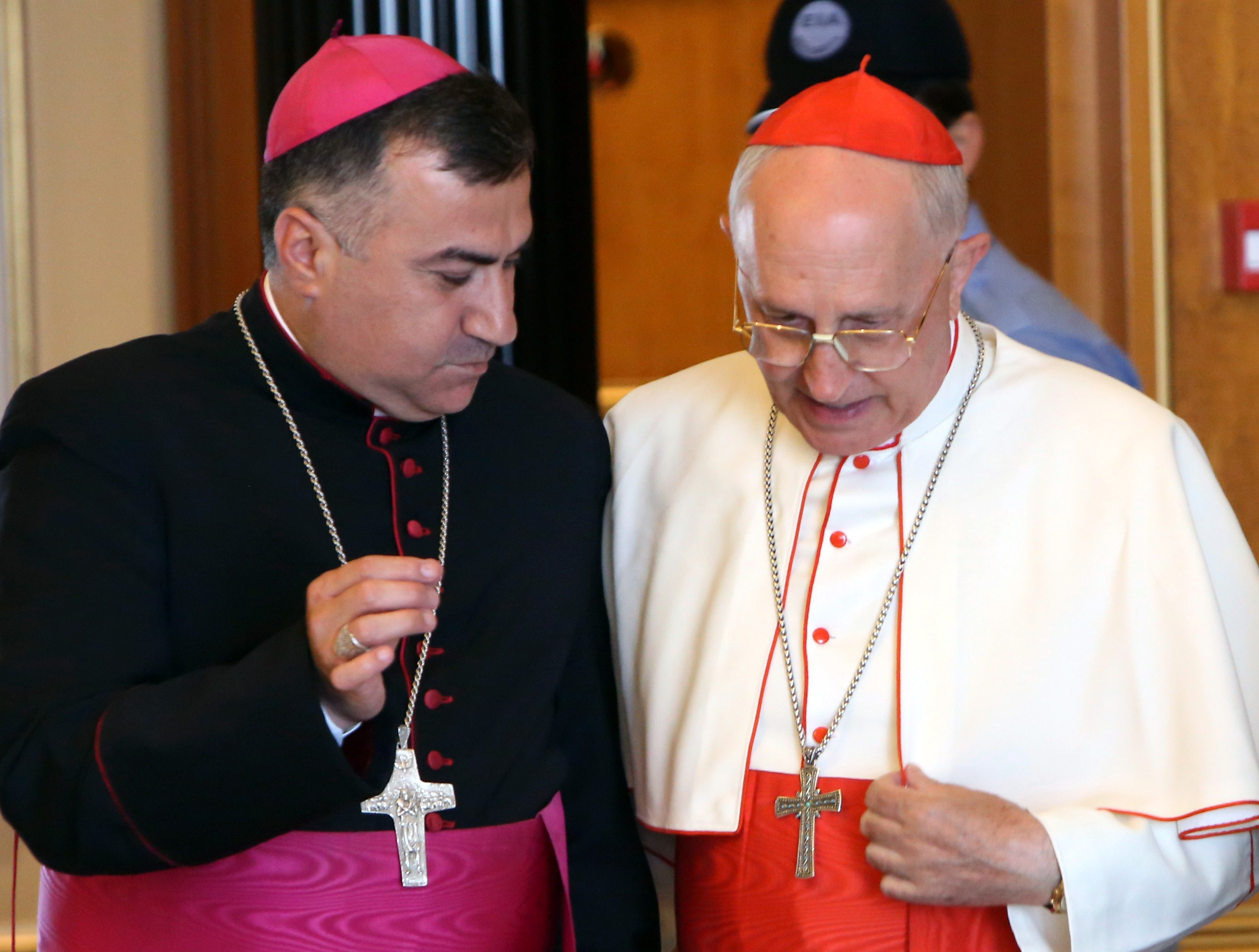Iraqi Archbishop Bashar Warda, the Chaldean Archbishop of Arbil, (L) speaks with Pope Francis' personal envoy to Iraq Cardinal Fernando Filoni in Arbil, the capital of the autonomous Kurdish region of northern Iraq on August 13, 2014. (SAFIN HAMED/AFP via Getty Images)
