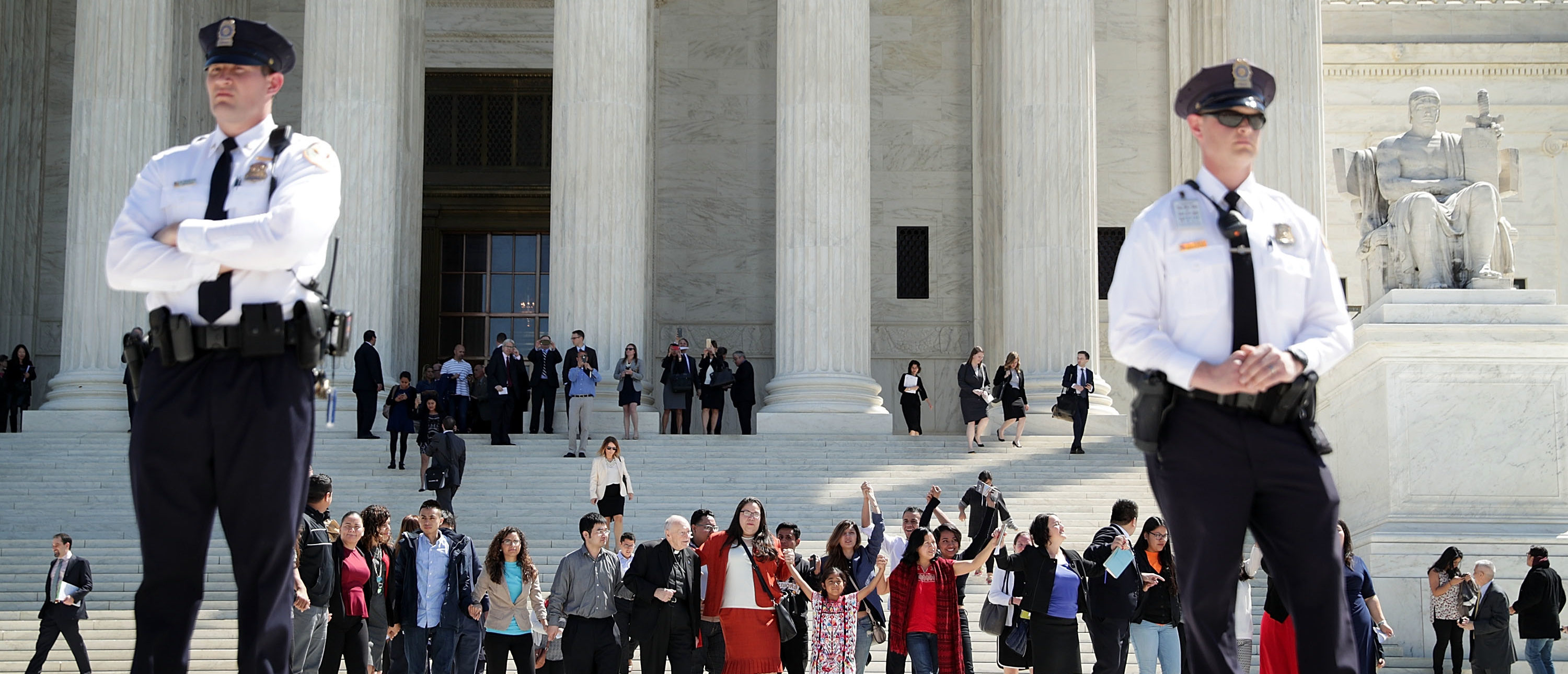 WASHINGTON, UNITED STATES - APRIL 18: Immigration supporters hold up their hands as they come out of the U.S. Supreme Court April 18, 2016 in Washington, DC. The Supreme Court heard oral arguments in the case of United States v. Texas, which is challenging President Obama's 2014 executive actions on immigration - the Deferred Action for Children Arrivals (DACA) and Deferred Action for Parents of American and Lawful Permanent Residents (DAPA) programs. (Photo by Alex Wong/Getty Images)