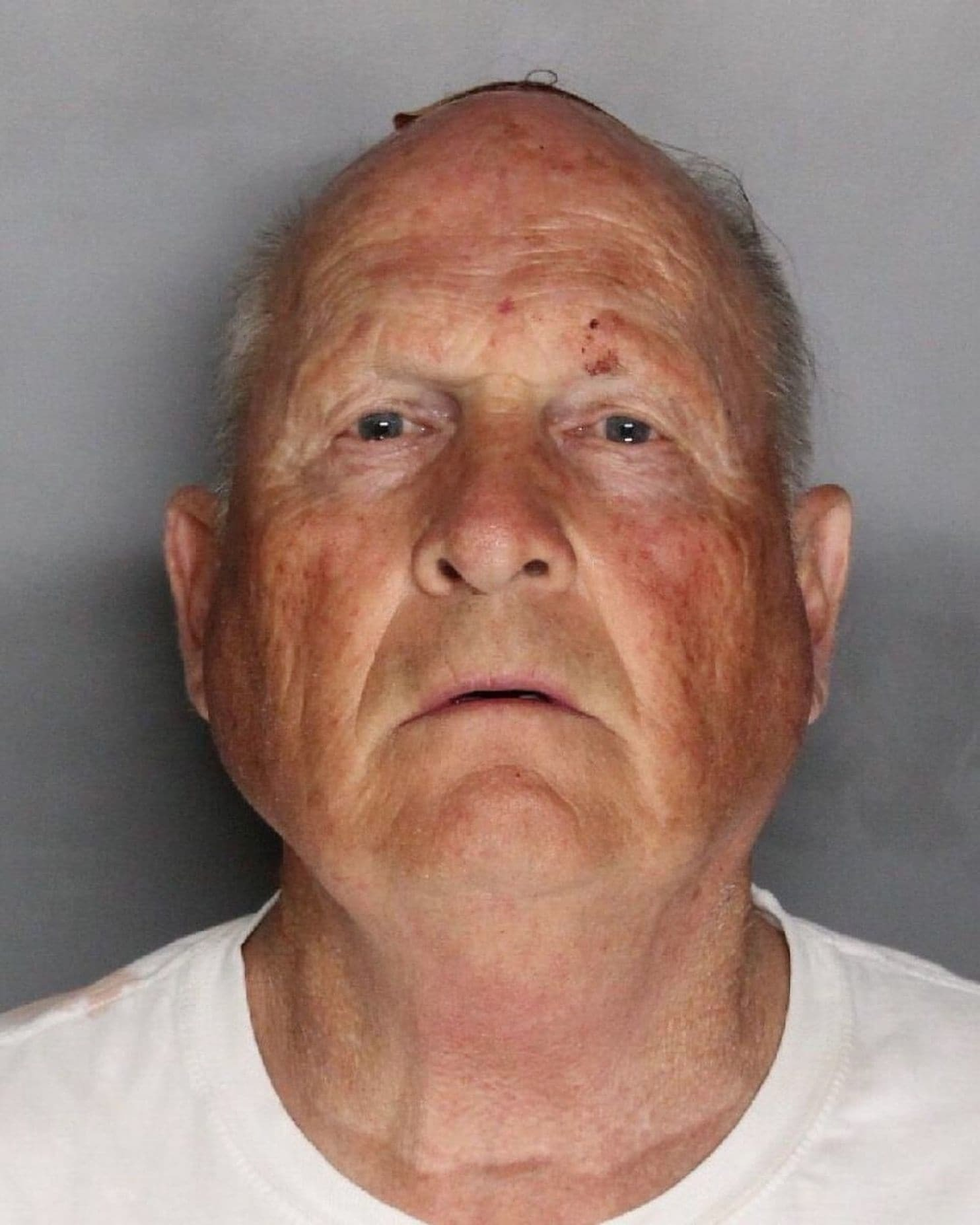 SACRAMENTO, CA - APRIL 25: In this handout provided by the Sacramento County Sheriff's Department, Joseph James DeAngelo, 72, is shown in his booking photo April 25, 2018 in Sacramento, California. DeAngelo was booked on two counts of murder, but police say he may be responsible for at least 12 murders and 45 rapes in a series of attacks that began more than 40 years ago, ending abruptly in 1986. (Photo by Sacramento County Sheriff's Department via Getty Images)