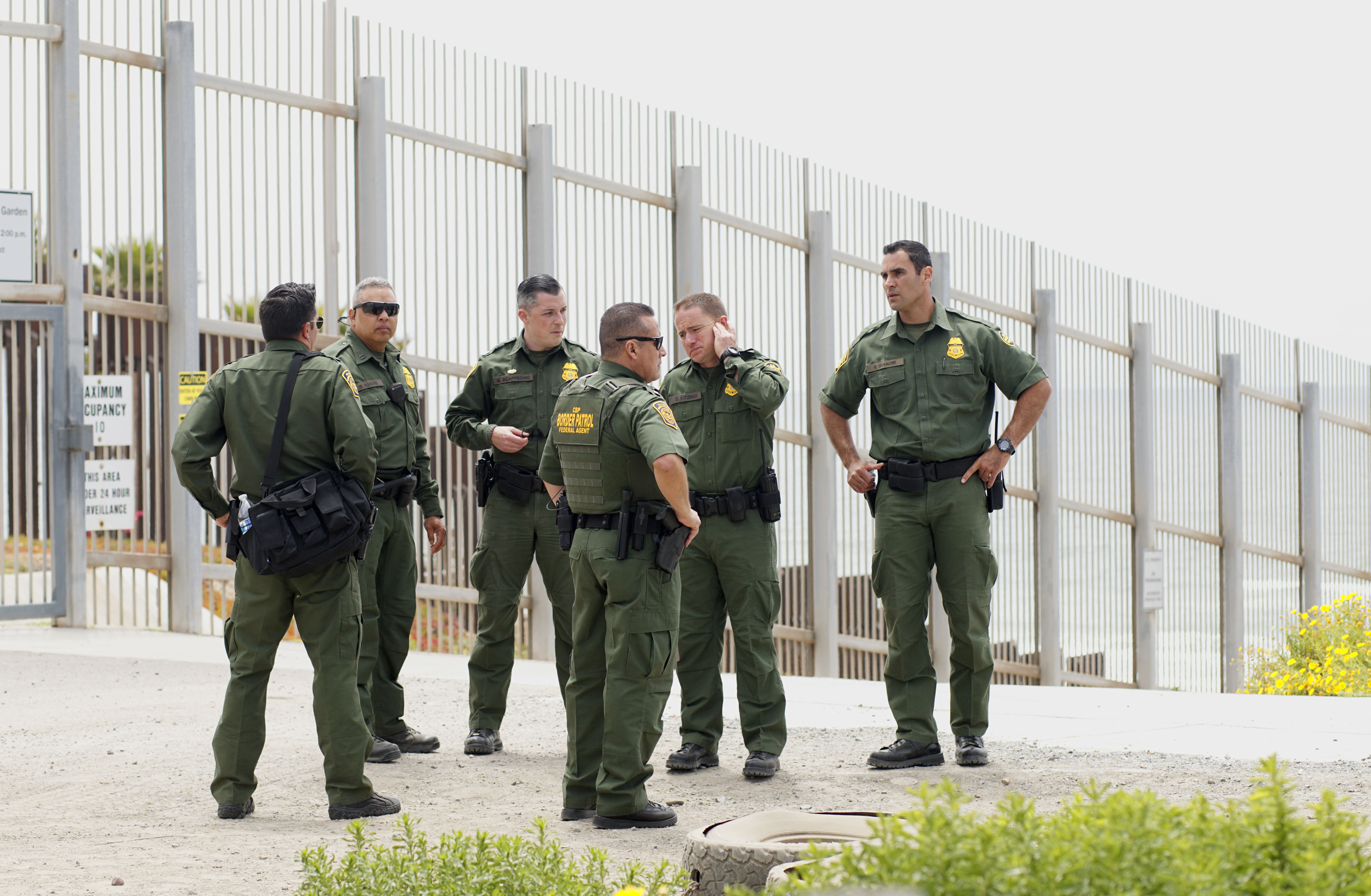 SAN YSIDRO, CA - MAY 7: Border Patrol agents patrol the area near where Attorney General Jeff Sessions addresses the media during a press conference at Border Field State Park on May 7, 2018 in San Ysidro, CA. Sessions was on a visit to the border along with ICE Deputy Director Thomas D. Homan to discuss the immigration enforcement actions of the Trump Administration. (Photo by Sandy Huffaker/Getty Images)