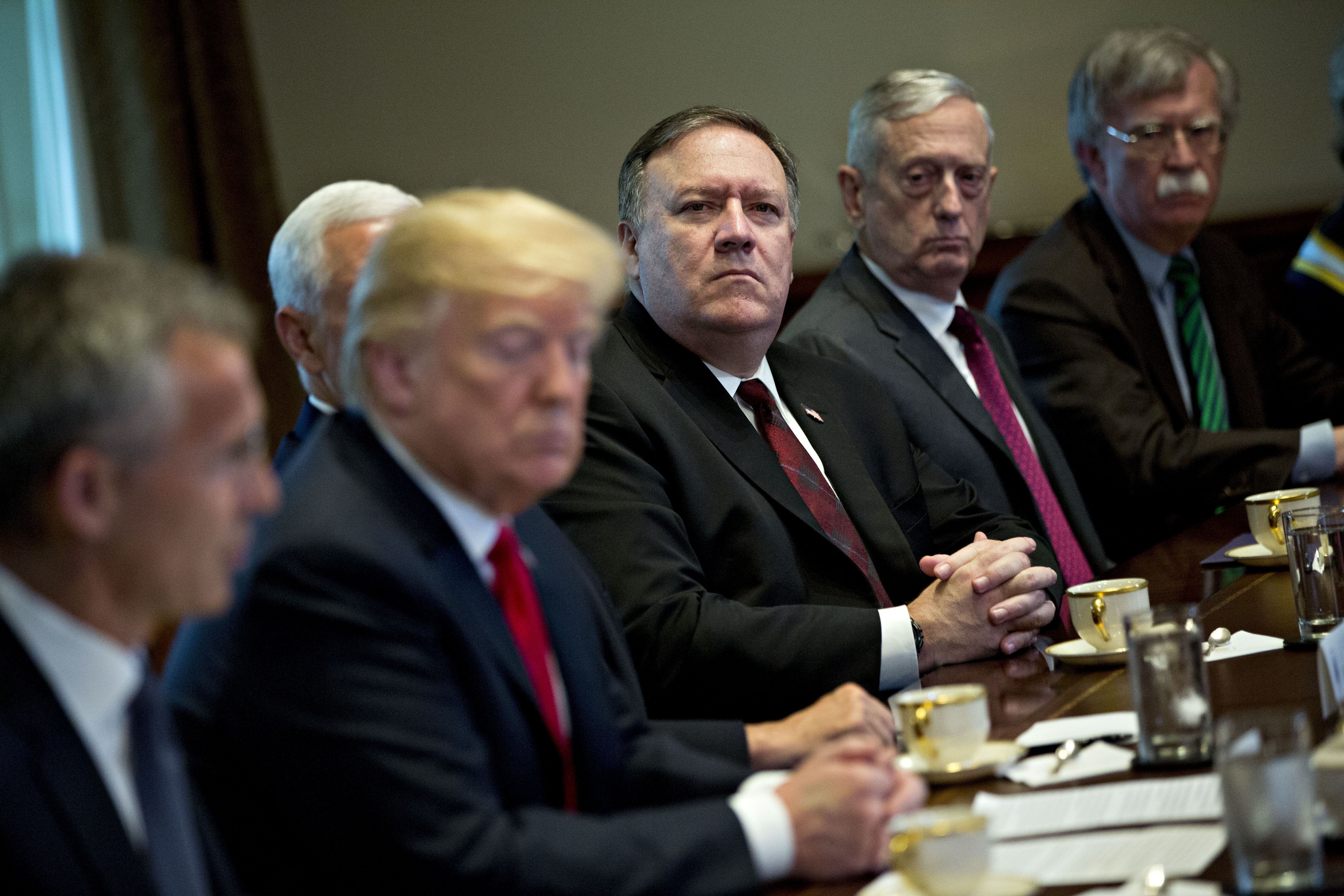 WASHINGTON, DC - MAY 17: John Bolton, national security advisor, from right, Jim Mattis, U.S. secretary of defense, and Mike Pompeo, U.S. secretary of state, listen during a meeting with U.S. President Donald Trump, second left, and Jens Stoltenberg, secretary general of the North Atlantic Treaty Organization (NATO), left, in the Cabinet Room of the White House May 17, 2018 in Washington, DC. The White House said the two leaders will be discussing the upcoming NATO Summit in July. (Photo by Andrew Harrer-Pool/Getty Images)