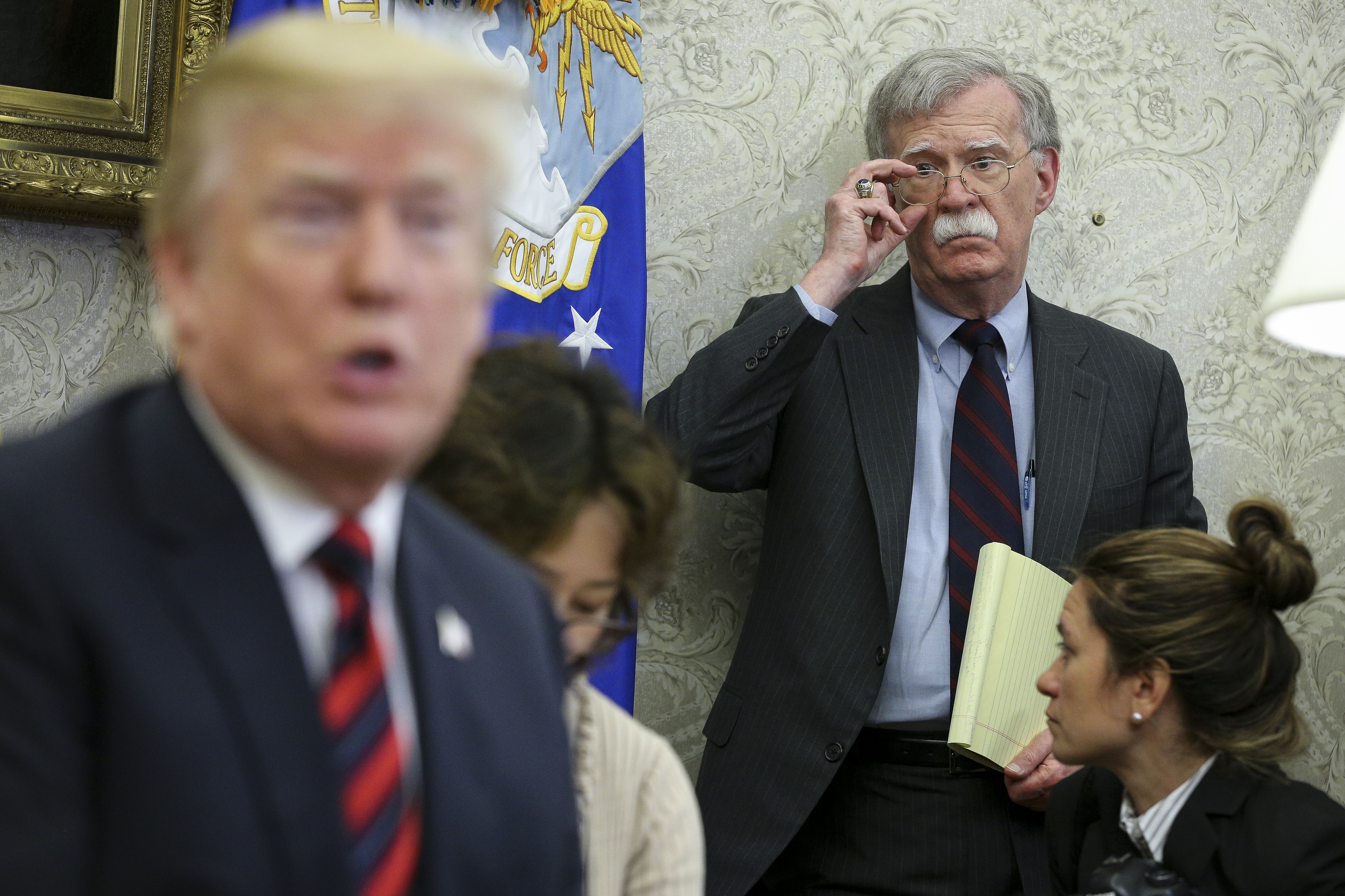 WASHINGTON, DC - MAY 22: US President Donald Trump speaks as National security advisor John Bolton listens during a meeting with South Korean President Moon Jae-in, in the Oval Office of the White House on May 22, 2018 in Washington DC. (Photo by Oliver Contreras-Pool/Getty Images)