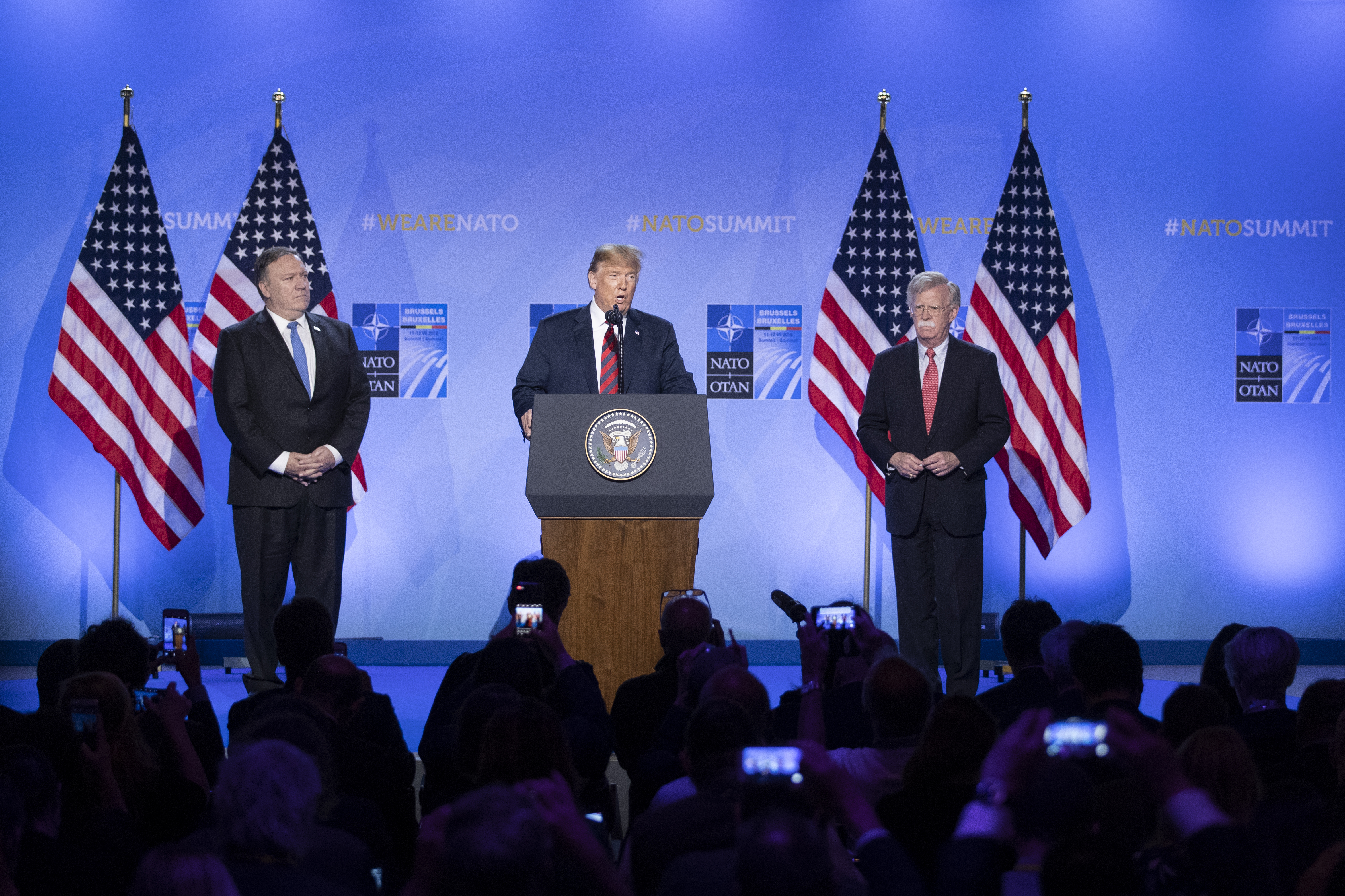 BRUSSELS, BELGIUM - JULY 12: U.S. President Donald Trump (C) speaks in between U.S. Secretary of State Mike Pompeo (L) and National Security Advisor John Bolton during a news conference at the 2018 NATO Summit at NATO headquarters on July 12, 2018 in Brussels, Belgium. Leaders from NATO member and partner states are meeting for a two-day summit, which is being overshadowed by strong demands by U.S. President Trump for most NATO member countries to spend more on defense. (Photo by Jasper Juinen/Getty Images)