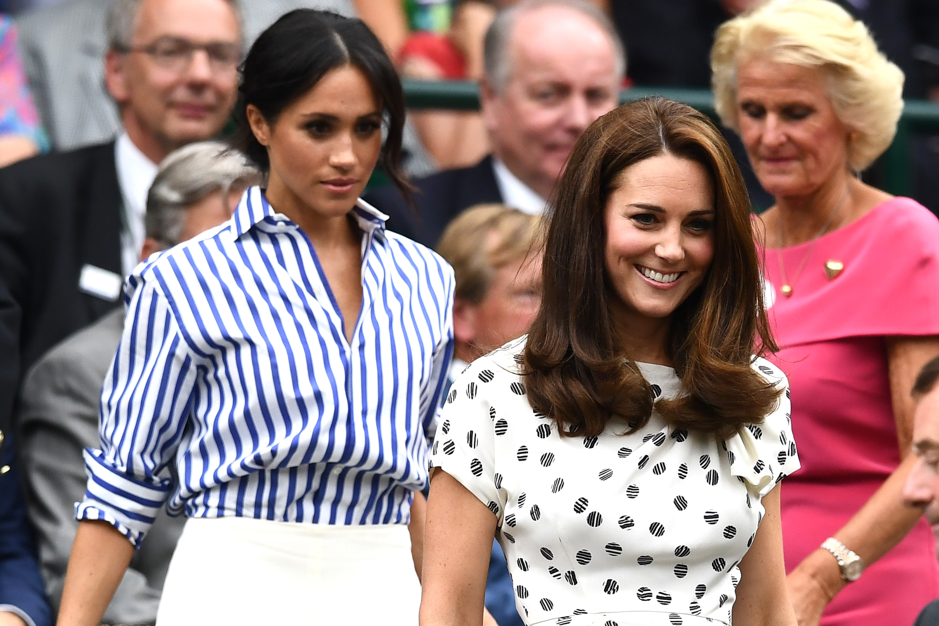 Meghan, Duchess of Sussex and Catherine, Duchess of Cambridge attend day twelve of the Wimbledon Lawn Tennis Championships at All England Lawn Tennis and Croquet Club on July 14, 2018 in London, England. (Photo by Clive Mason/Getty Images)