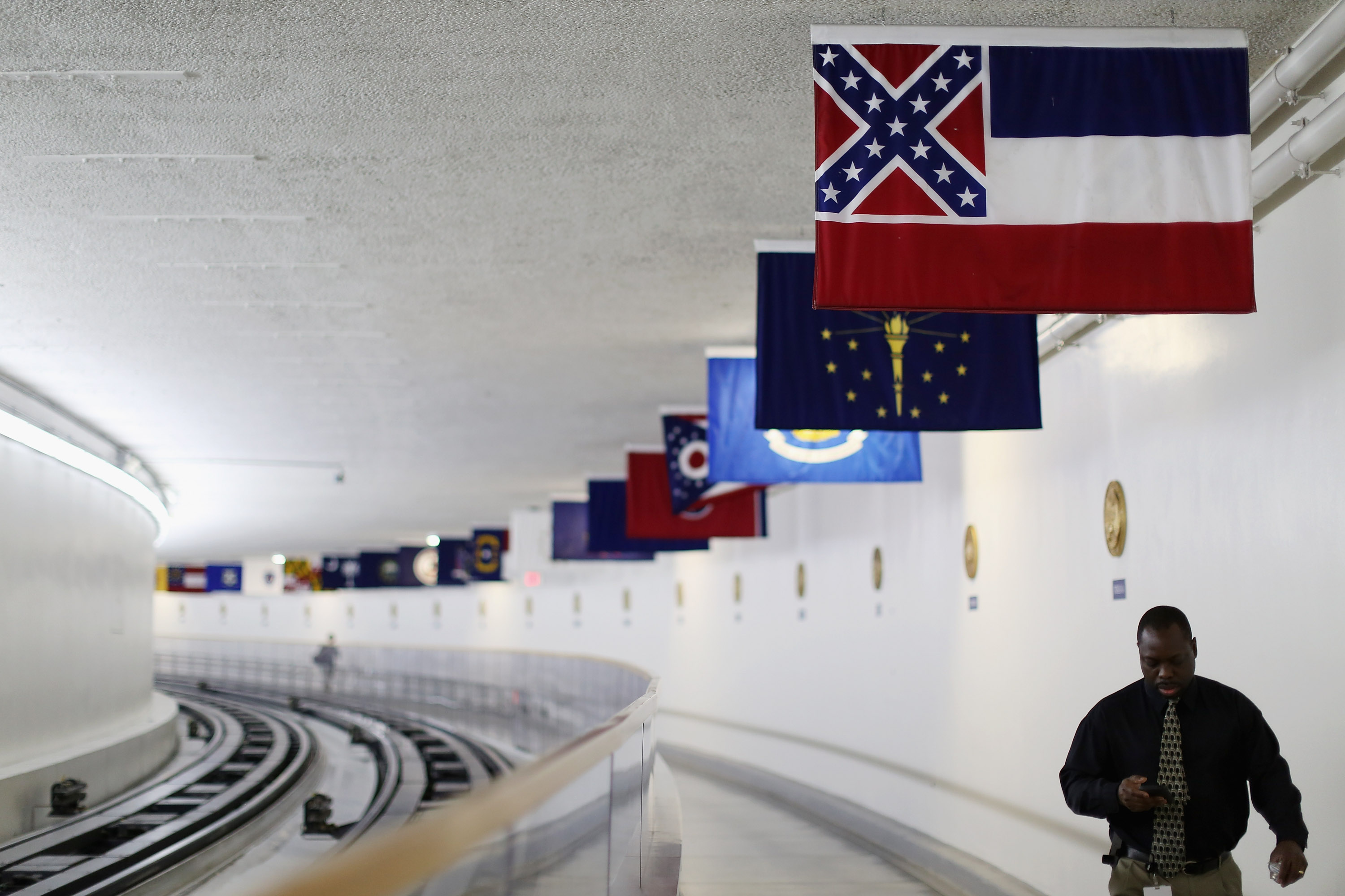 The state flag of Mississippi, which incorporates the flag of the Confederate States of America in the top left corner, is displayed with the flags of the other 49 states and territories in the tunnel connecting the senate office building and the U.S. Capitol June 23, 2015 in Washington, DC. (Photo by Chip Somodevilla/Getty Images)
