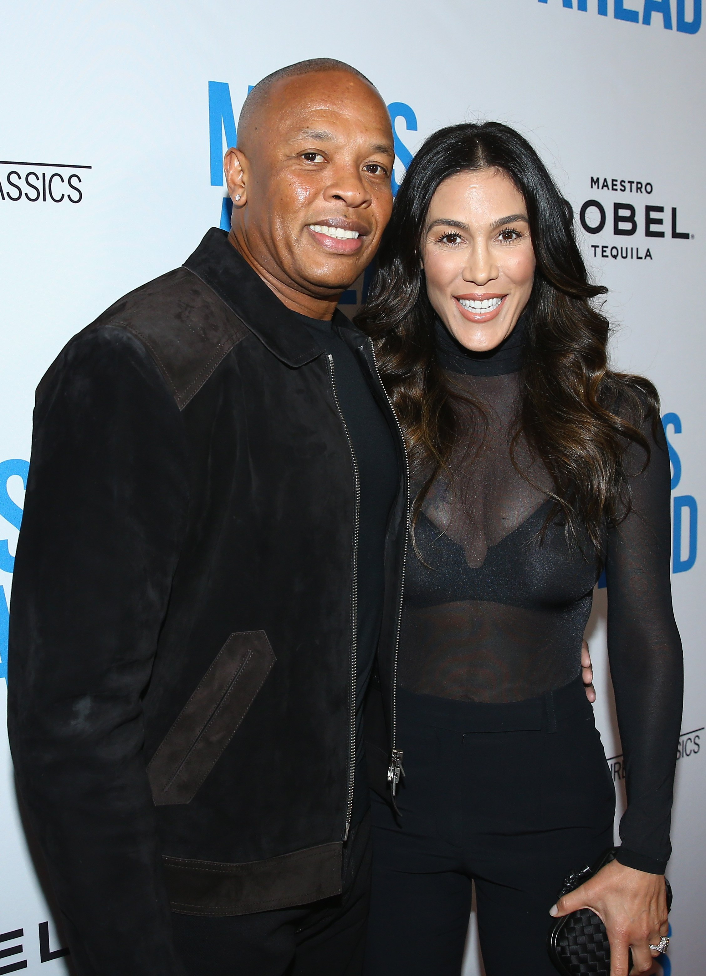 """Dr. Dre and Nicole Young attend the premiere of Sony Pictures Classics' """"Miles Ahead"""" at Writers Guild Theater on March 29, 2016 in Beverly Hills, California. (Photo by Mark Davis/Getty Images)"""