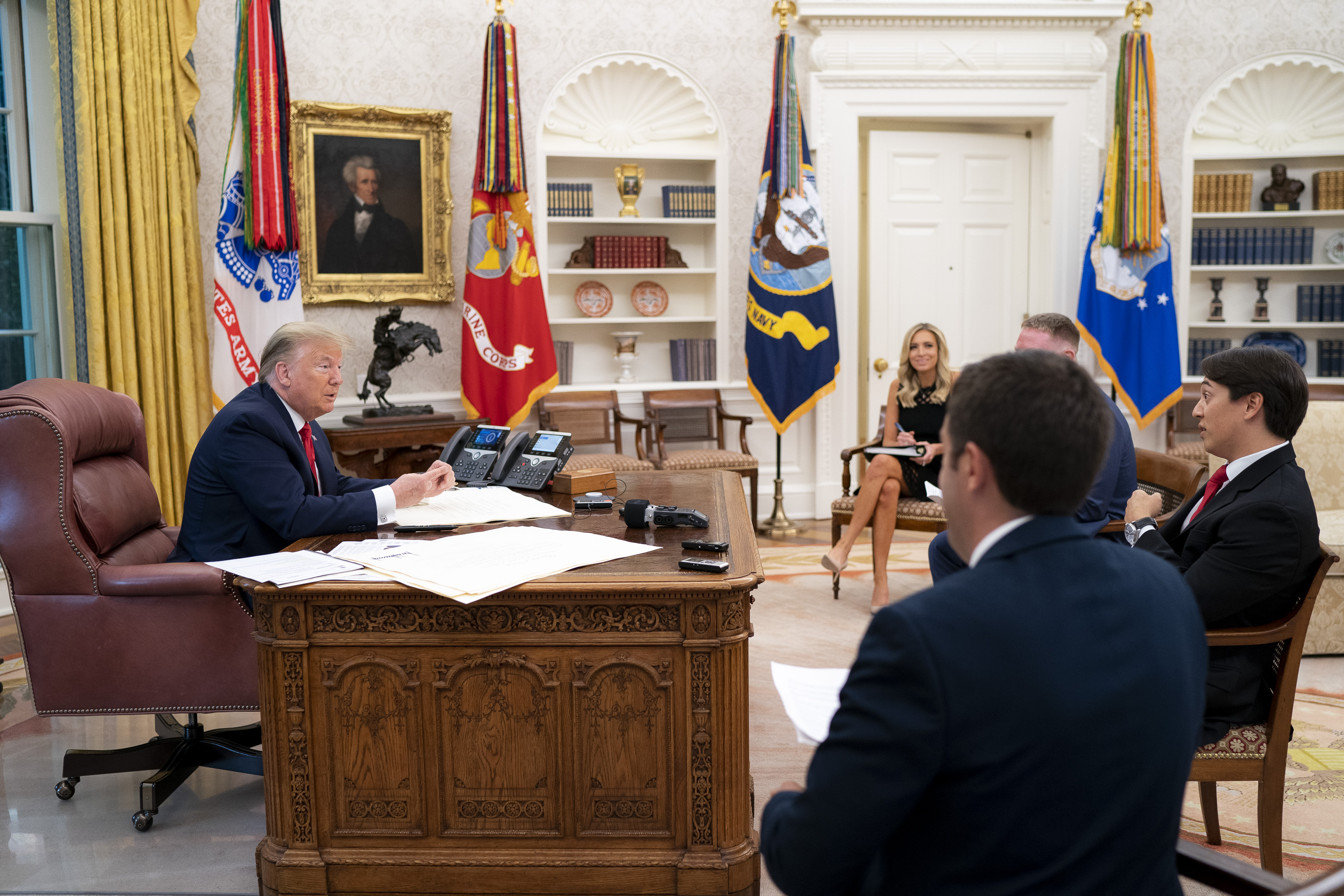 President Donald Trump sits down for an Oval Office interview with Daily Caller's Christian Datoc, Vince Coglianese, and Geoff Ingersoll (White House Photo by Tia Dufour)