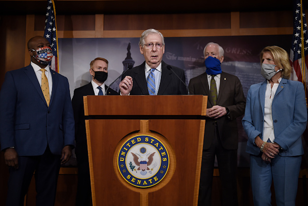Senate Majority Leader Mitch McConnell flanked by (L to R) Sen. Tim Scott, R-SC, Sen. James Lankford, R-OK, Sen. John Cornyn, R-TX, and Sen. Shelley Moore Capito, R-WV, speaks at a news conference to announce a Republican police reform bill a news conference to announce that the Senate will consider police reform legislation, at the US Capitol on June 17, 2020 in Washington, DC. (Photo by Olivier DOULIERY / AFP) (Photo by OLIVIER DOULIERY/AFP via Getty Images)