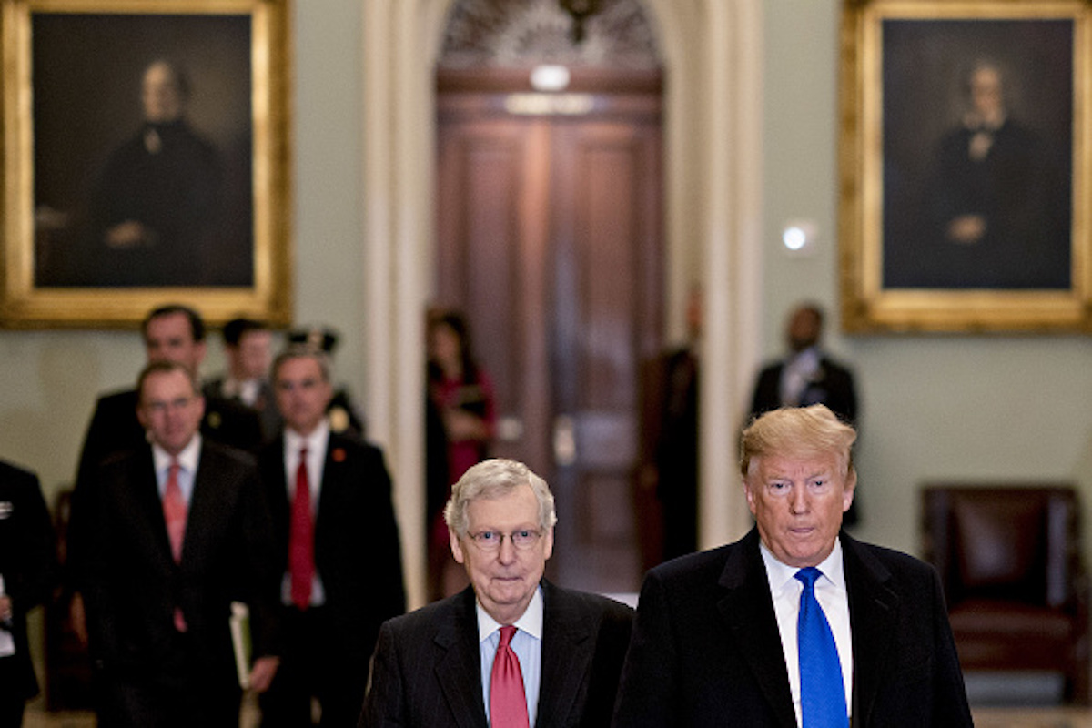 U.S. President Donald Trump, right, arrives for a Senate Republican policy luncheon with Senate Majority Leader Mitch McConnell, a Republican from Kentucky, at the U.S. Capitol in Washington, D.C., U.S., on Tuesday, March 26, 2019. Trump last week intended to reverse sanctions imposed on two Chinese shipping companies accused of violating North Korea trade prohibitions, until officials in his administration persuaded him to back off and then devised a misleading explanation of his vague tweet announcing the move. Photographer: Andrew Harrer/Bloomberg via Getty Images