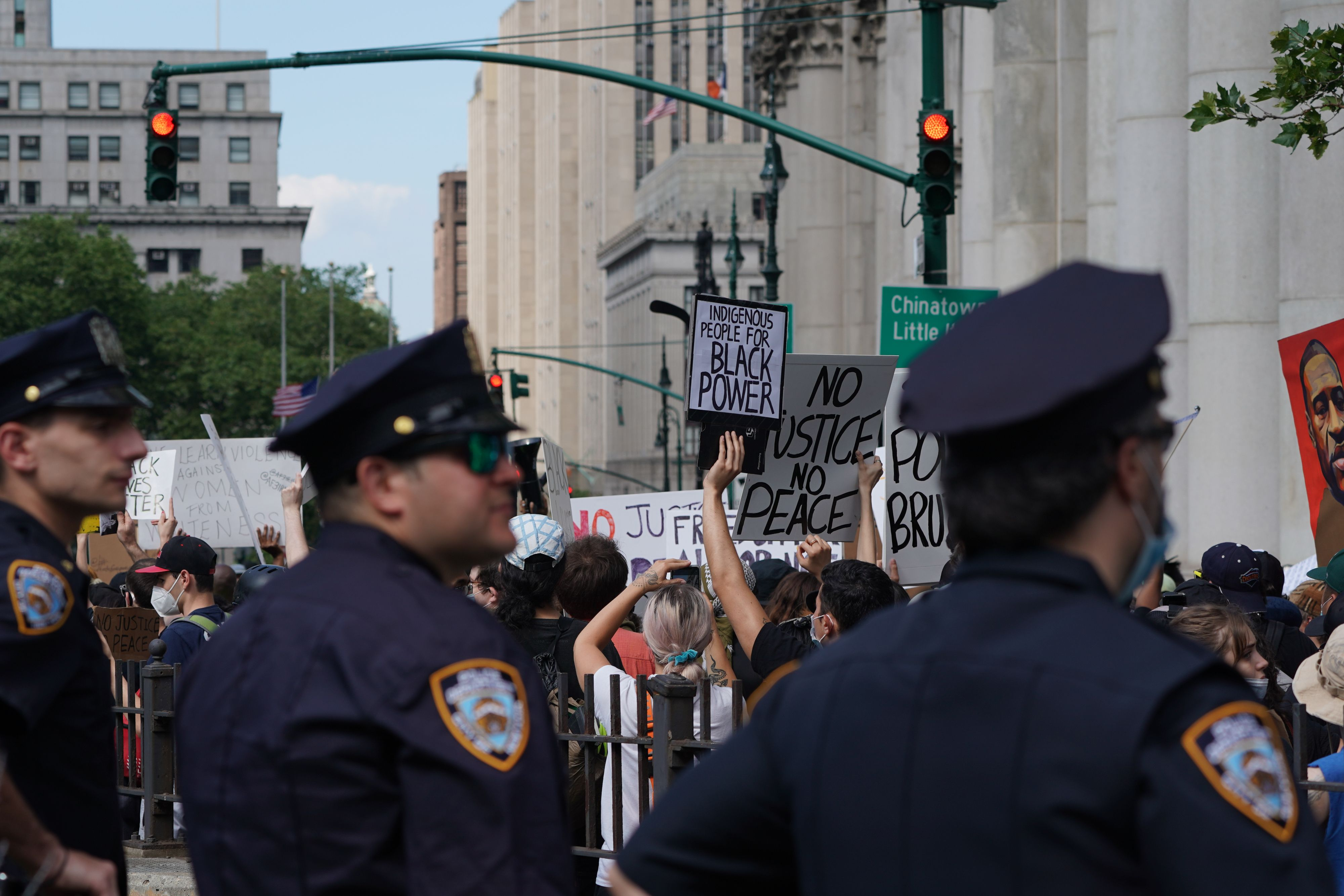 New York City Police look on as protesters march into Manhattan from the Brooklyn Bridge over the death of George Floyd by Minneapolis Police on June 19, 2020 in New York. - The US marks the end of slavery by celebrating Juneteenth, with the annual unofficial holiday taking on renewed significance as millions of Americans confront the nation's living legacy of racial injustice. (Photo by Bryan R. Smith / AFP)