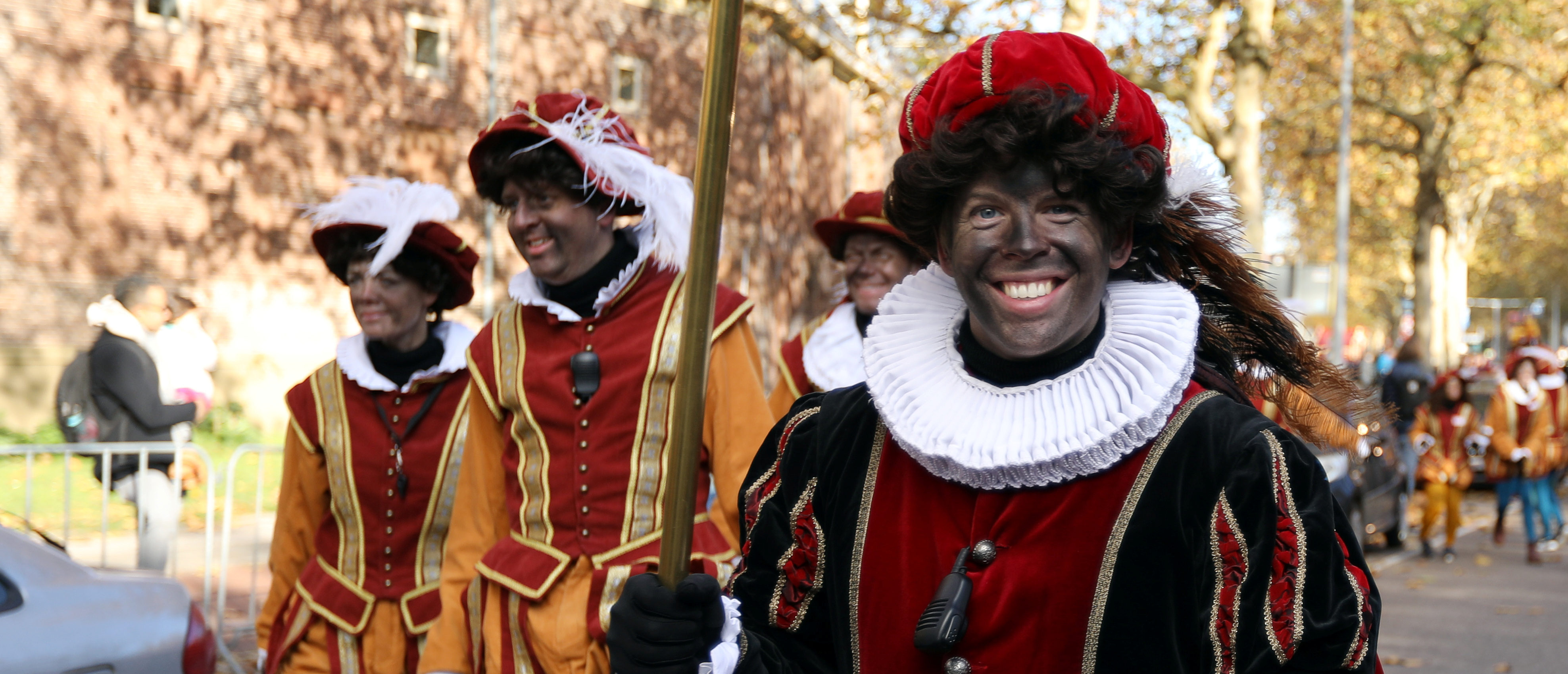 """""""Zwarte Piet"""" (Black Pete), who are a Saint Nicholas' assistants are seen during a traditional parade in Amsterdam, Netherlands, November 18, 2018. REUTERS/Eva Plevier - RC1169DA3850"""
