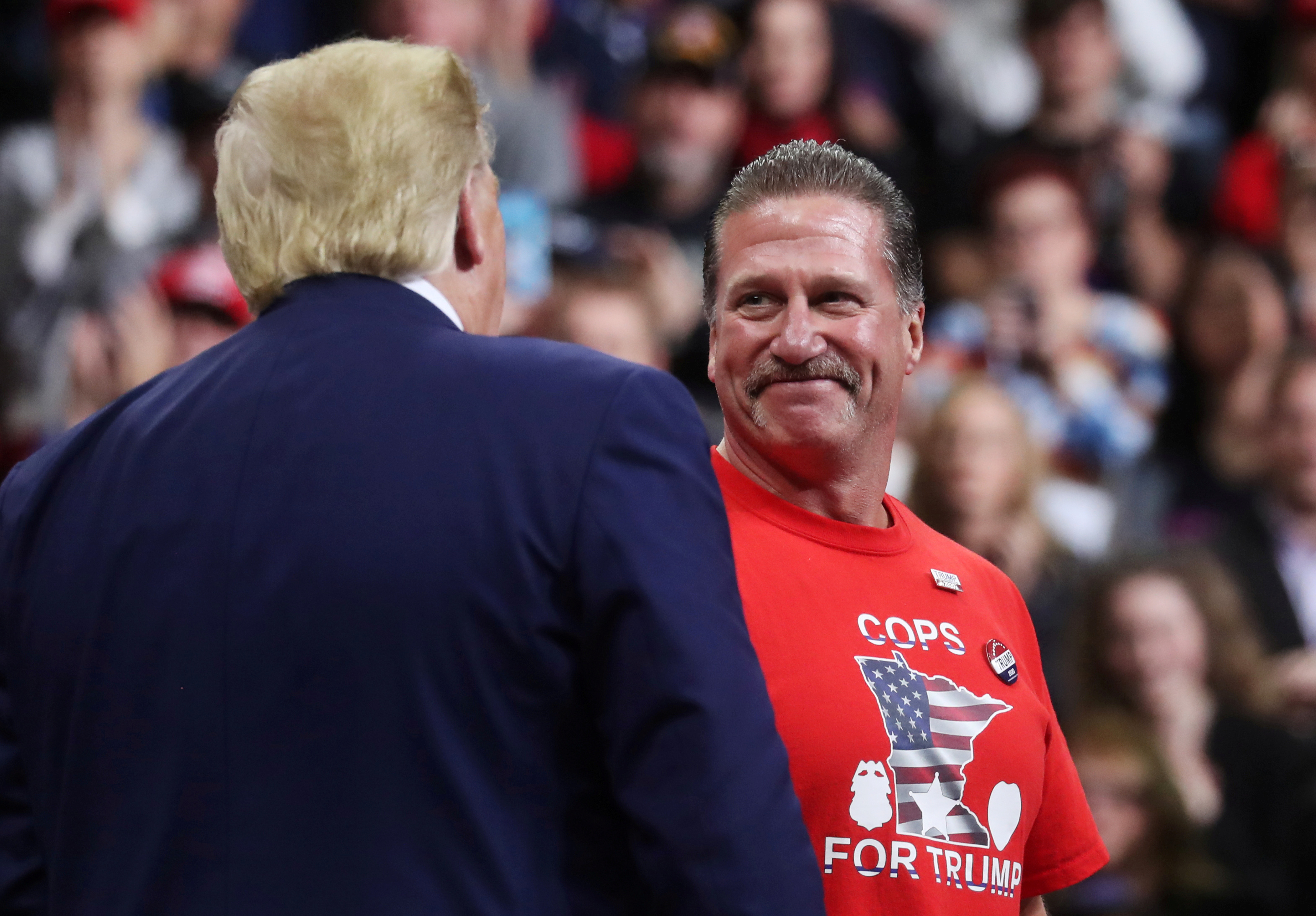 President Donald Trump greets Bob Kroll, president of the Minneapolis police union, during a campaign rally in Minneapolis, Minnesota, U.S., October 10, 2019. (Photo: Reuters/Leah Millis/File Photo)