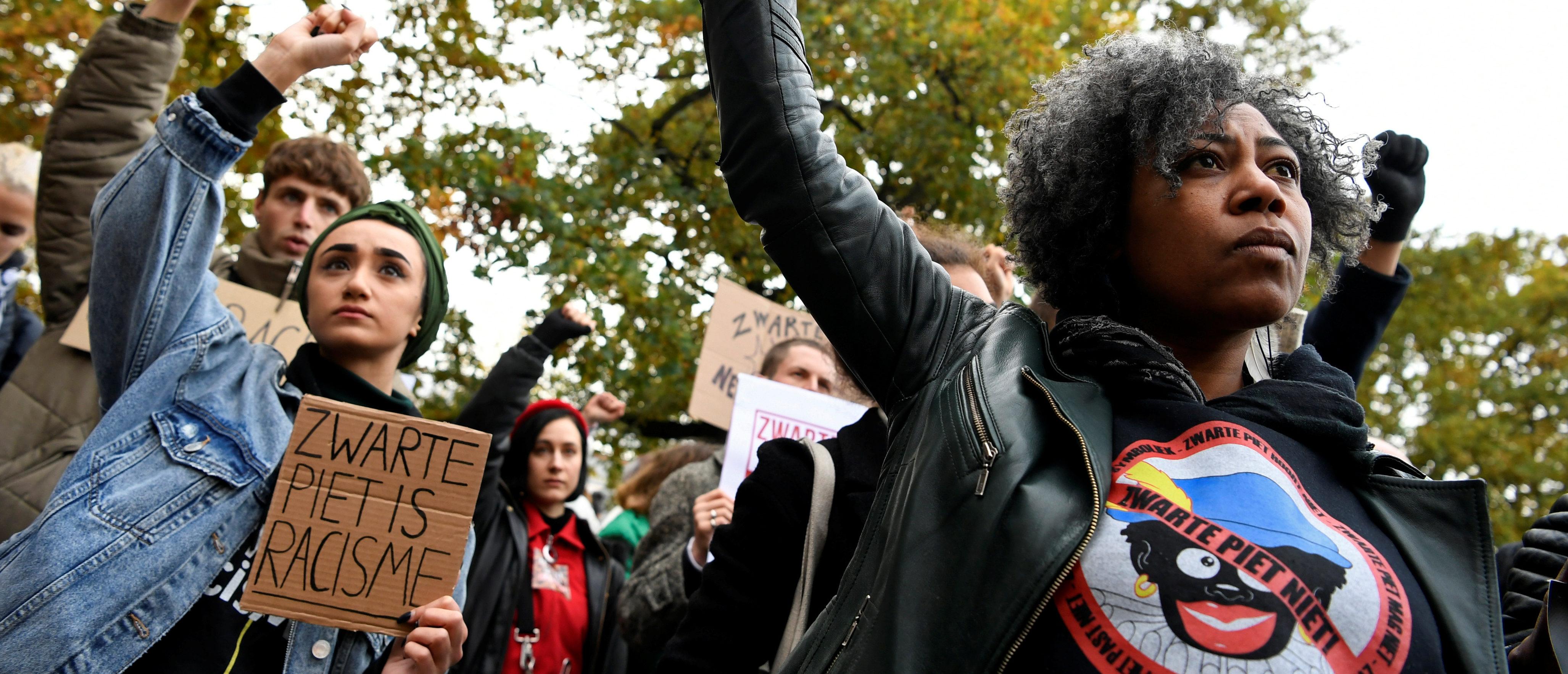 "People protest against the arrival of Saint Nicholas and his assistants called ""Zwarte Piet"" (Black Pete) in The Hague, Netherlands, November 16, 2019. REUTERS/Piroschka van de Wouw - RC2DCD9Q27LQ"
