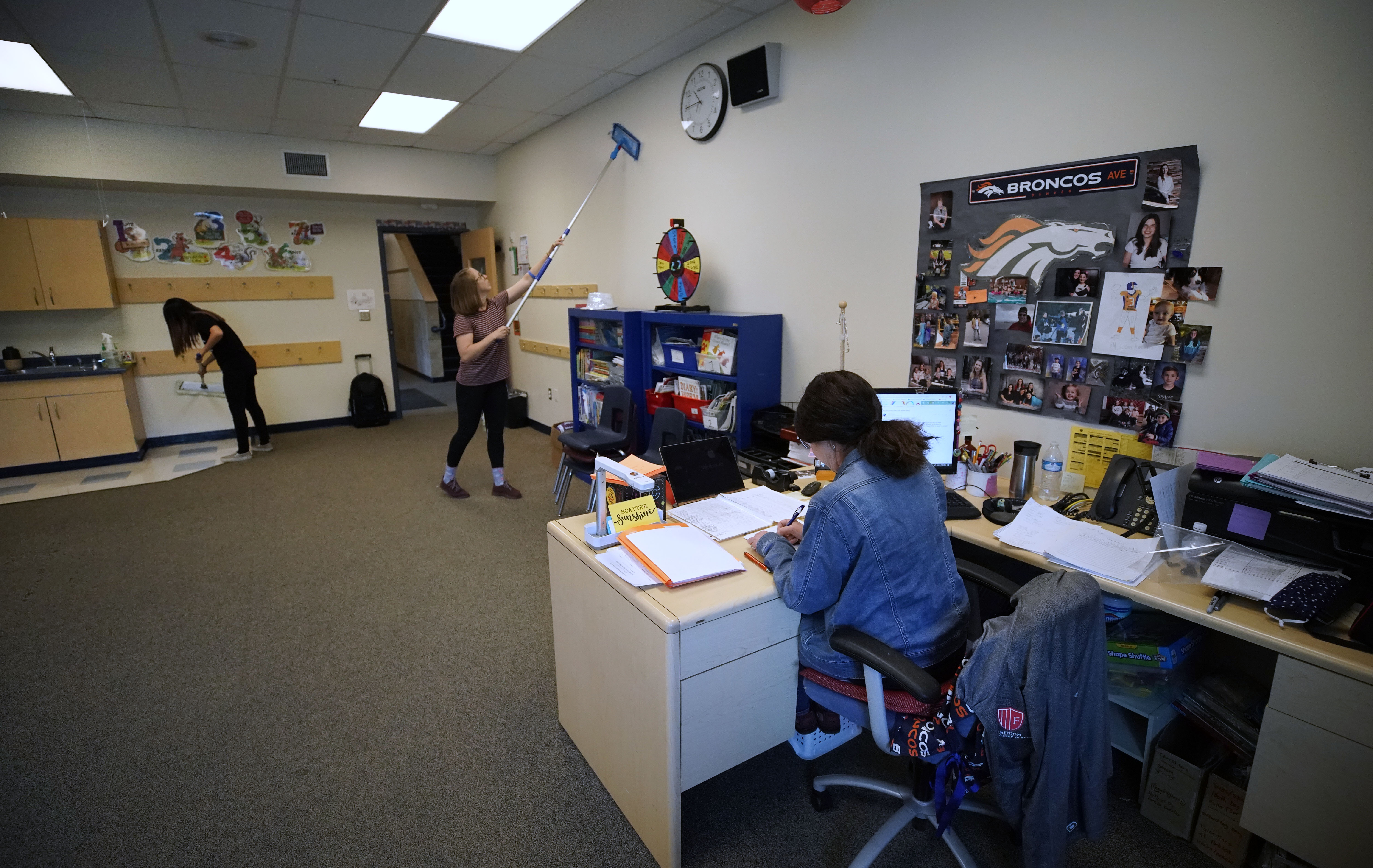 PROVO, UT - MAY 18: As a teacher figures out the final grades for her students workers clean the walls in a classroom at Freedom Preparatory Academy on May 18, 2020 in Provo, Utah. Freedom Academy an elementary school was closed on March 16, 2020 along with all other school in Utah due to the order of the Utah Governor due to the COVID-19 pandemic. (Photo by George Frey/Getty Images)