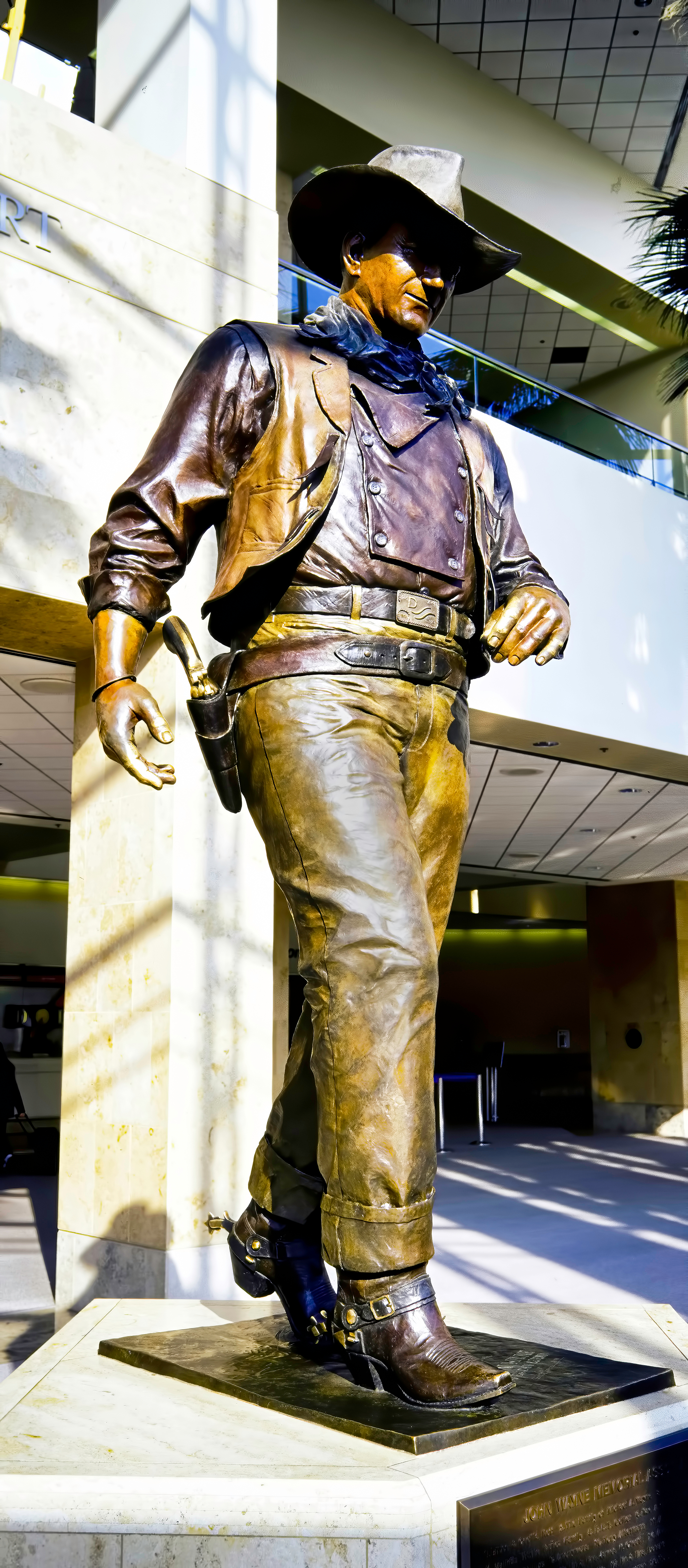 Orange County, California , May ,2010 - On June 20, 1979, the Orange County Board of Supervisors renamed Orange County Airport to John Wayne Airport. Showing a life size bronze statue of John Wayne ""