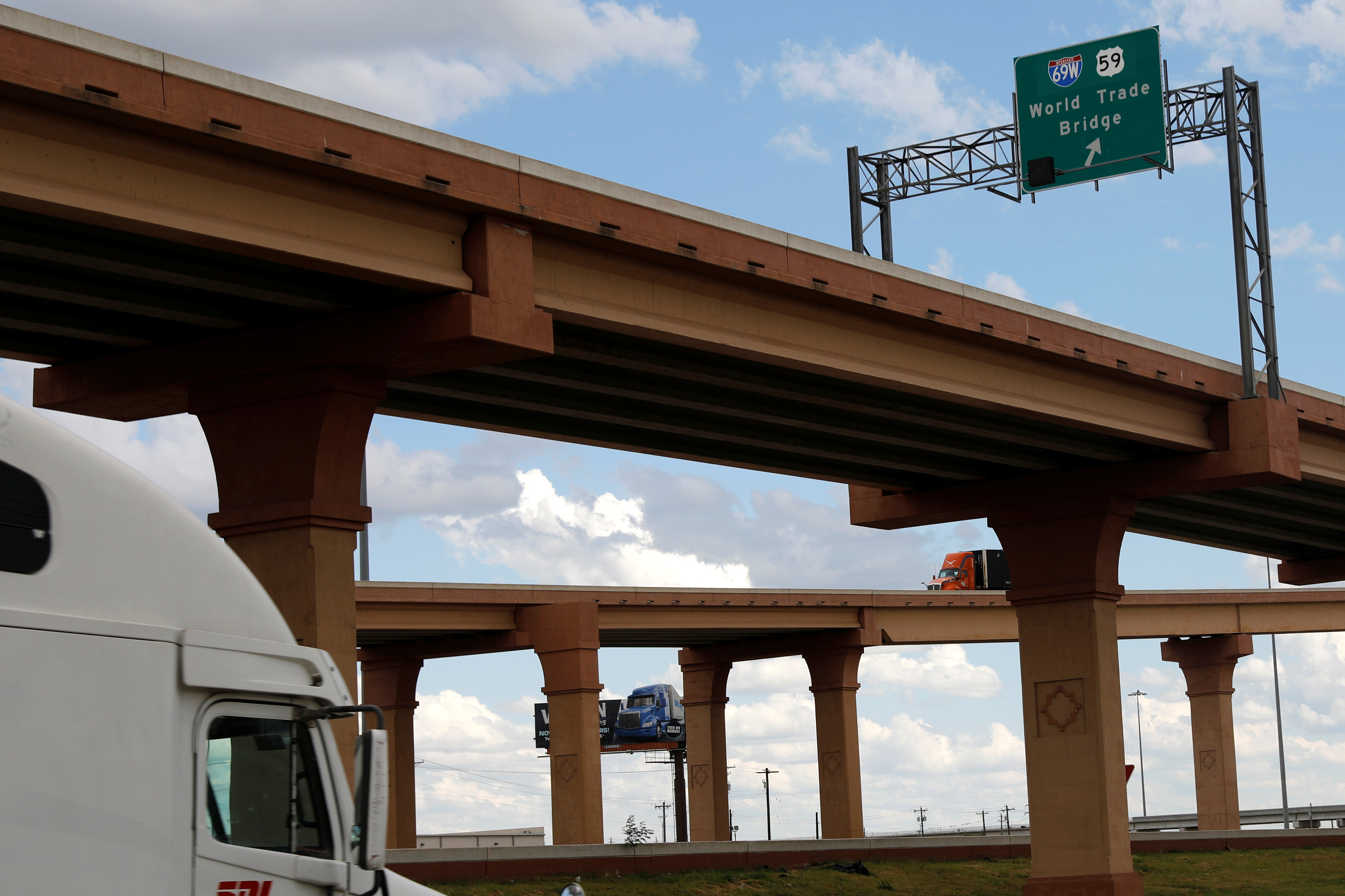 Trucks are seen on a bridge intersection near the World Trade Bridge border, in Laredo, Texas U.S. June 3, 2019. REUTERS/Carlos Jasso