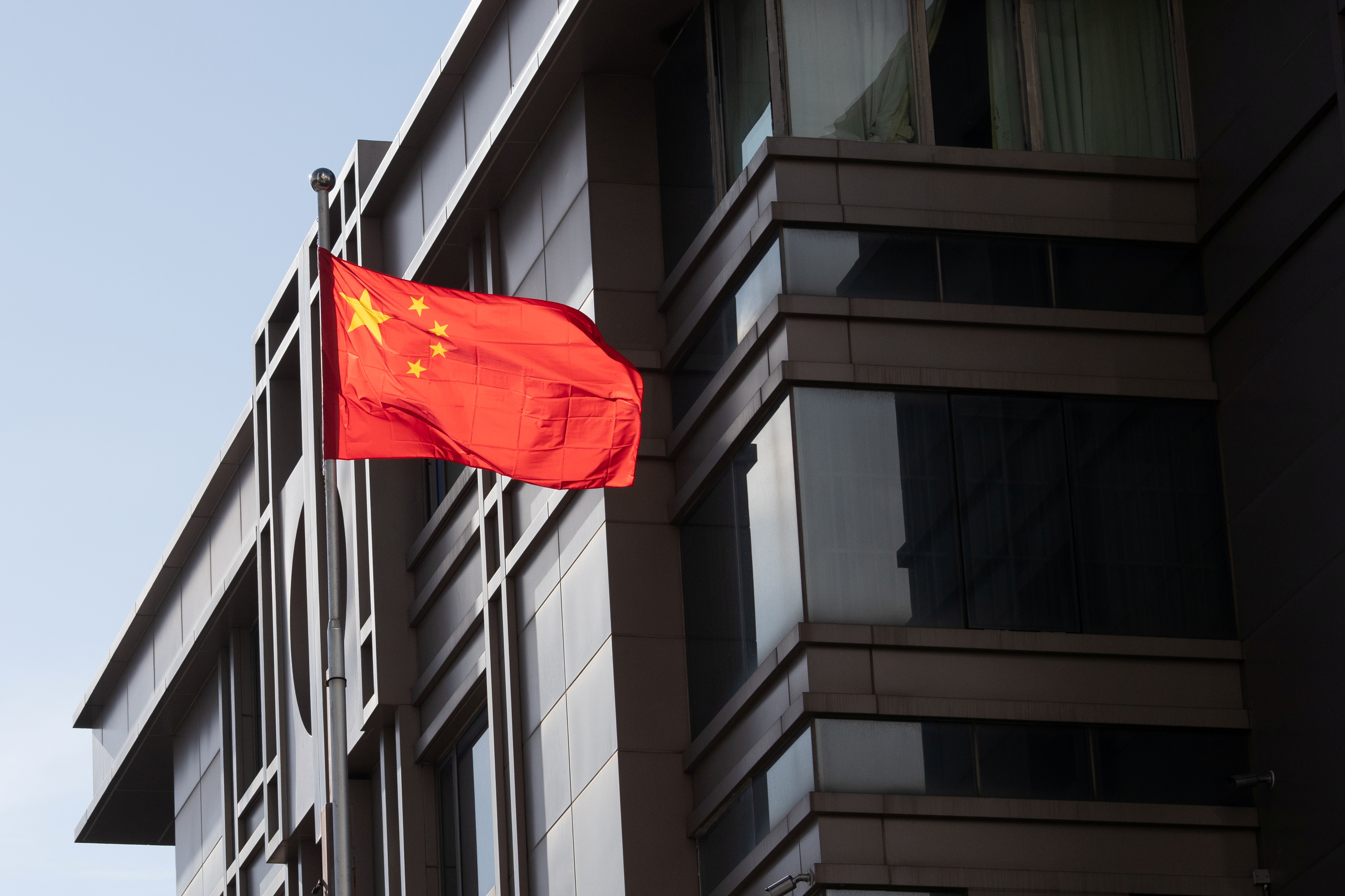 China's national flag is seen waving at the China Consulate General in Houston, Texas, U.S., July 22, 2020. REUTERS/Adrees Latif