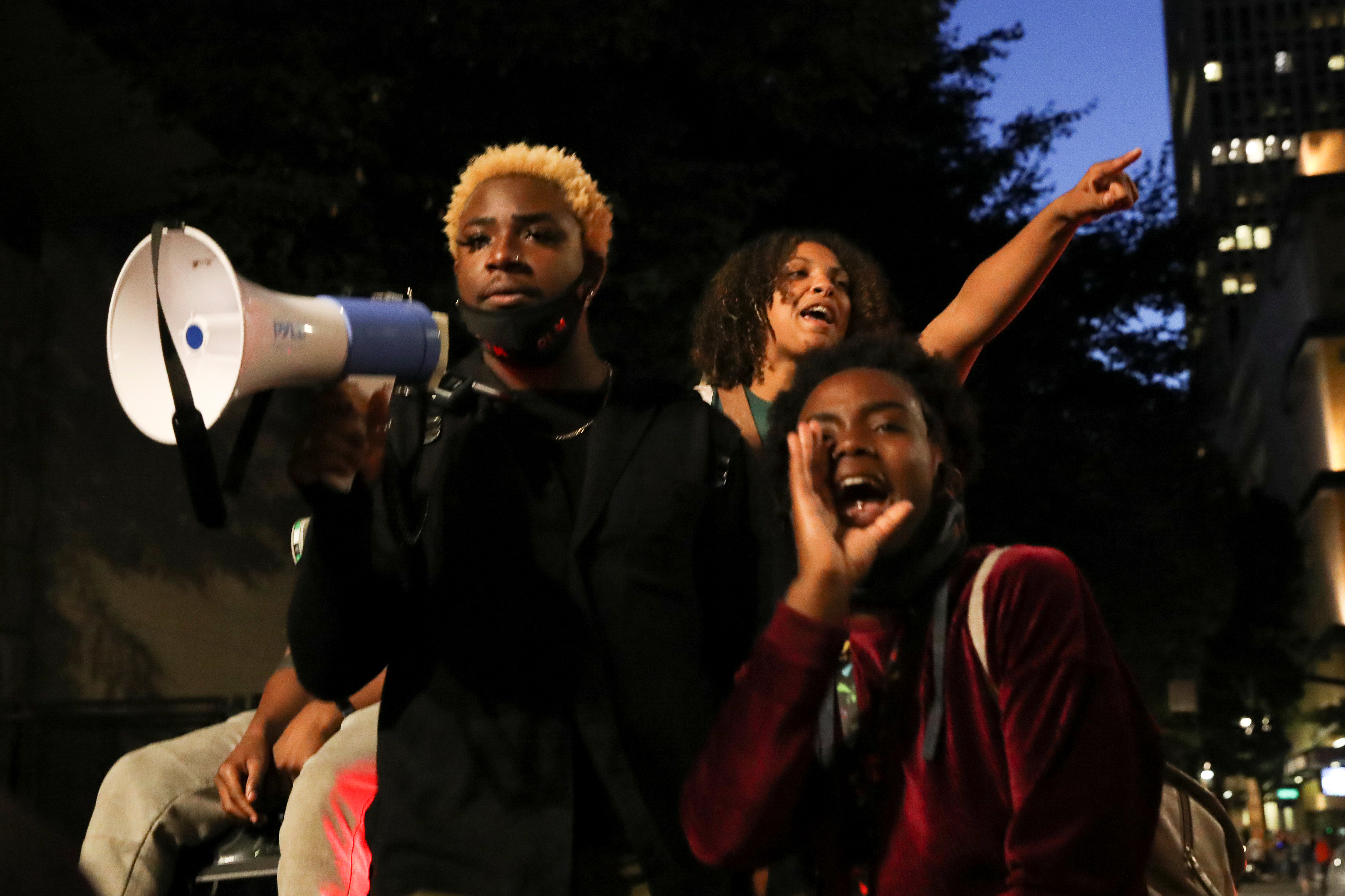Black Lives Matter demonstrators take part in a protest against racial inequality and police violence in Portland, Oregon, U.S., July 24, 2020. REUTERS/Caitlin Ochs